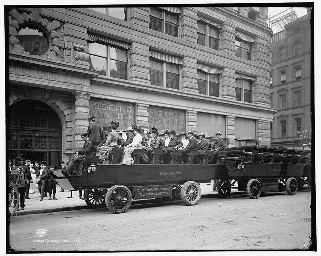 """Circa 1904. """"Seeing New York."""" Electric omnibuses at the Flatiron Building. 8x10 inch dry plate glass negative, Detroit Publishing Company"""