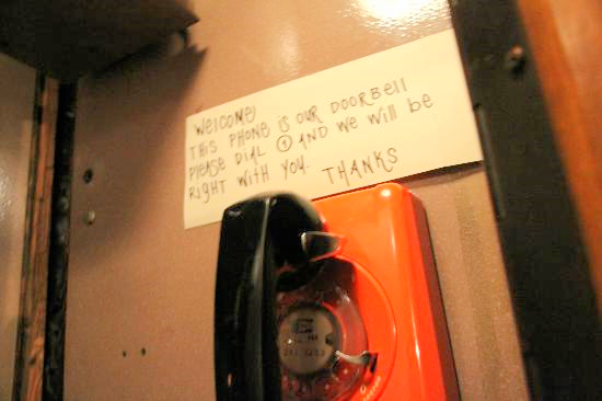 Dial 1 and the hostess opens the door on the back of the phone booth