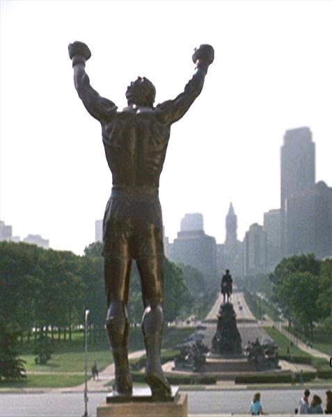 Statue in front of Philadelphia Museum of Art celebrating the classic scene of Sylvester Stallone sprinting up the museum steps in  Rocky .