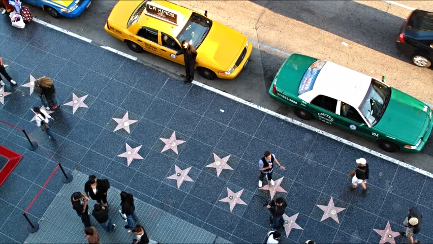 Walk of Fame    The Hollywood Walk of Fame comprises more than 2,500 five-pointed terrazzo and brass stars embedded in the sidewalks along 15 blocks ofHollywood Boulevard and three blocks of Vine Street in Hollywood, California.