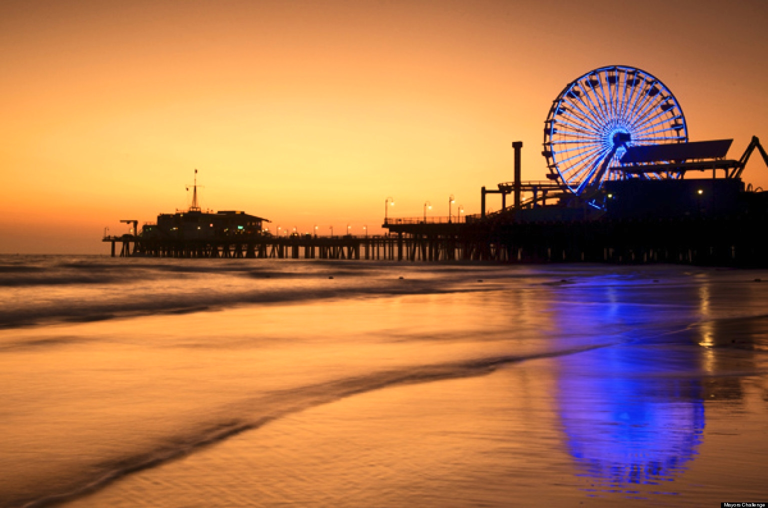 Santa Monica Beach    Santa Monica is a city west of downtown Los Angeles. Santa Monica Beach is fringed by Palisades Park, with views over the Pacific Ocean. The storied Santa Monica Pier is home to the Pacific Park amusement park, historic Looff Hippodrome Carousel and Santa Monica Pier Aquarium. Next to the pier is Muscle Beach, an outdoor gym established in the 1930s. In the city center, Bergamot Station houses several art galleries.