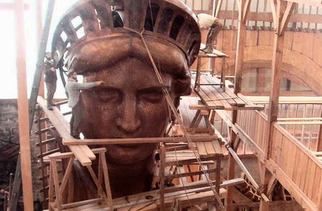 The Statue of Liberty was originally reddish-brown in color. Its present green color is due to patination. Patination is a process whereby copper turns blue-green due to exposure to air. The Statue of Liberty took about 25 years to change from its original reddish-brown color. In 1906, when the copper was still undergoing patination, politicians became concerned, and Congress allocated $62,000 to have her painted. This resulted in an outrage, and the plan was shelved. On the positive side, the patina protects the statue as it stops the copper from wearing away. (Image credit: Wikimedia Commons)