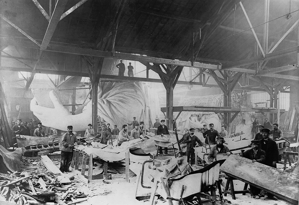 Workmen constructing the Statue of Liberty in Bartholdi's Parisian warehouse workshop; first model; left hand; and quarter-size head–Winter 1882.(Photo by Albert Fernique (1841-1898) / Library of Congress)