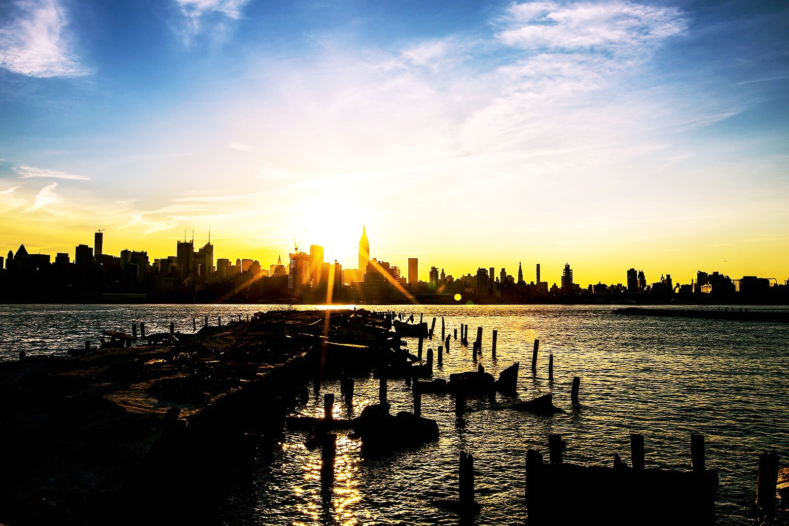 Sun rising from Hoboken, NJ.  Click here to learn more about Hoboken .