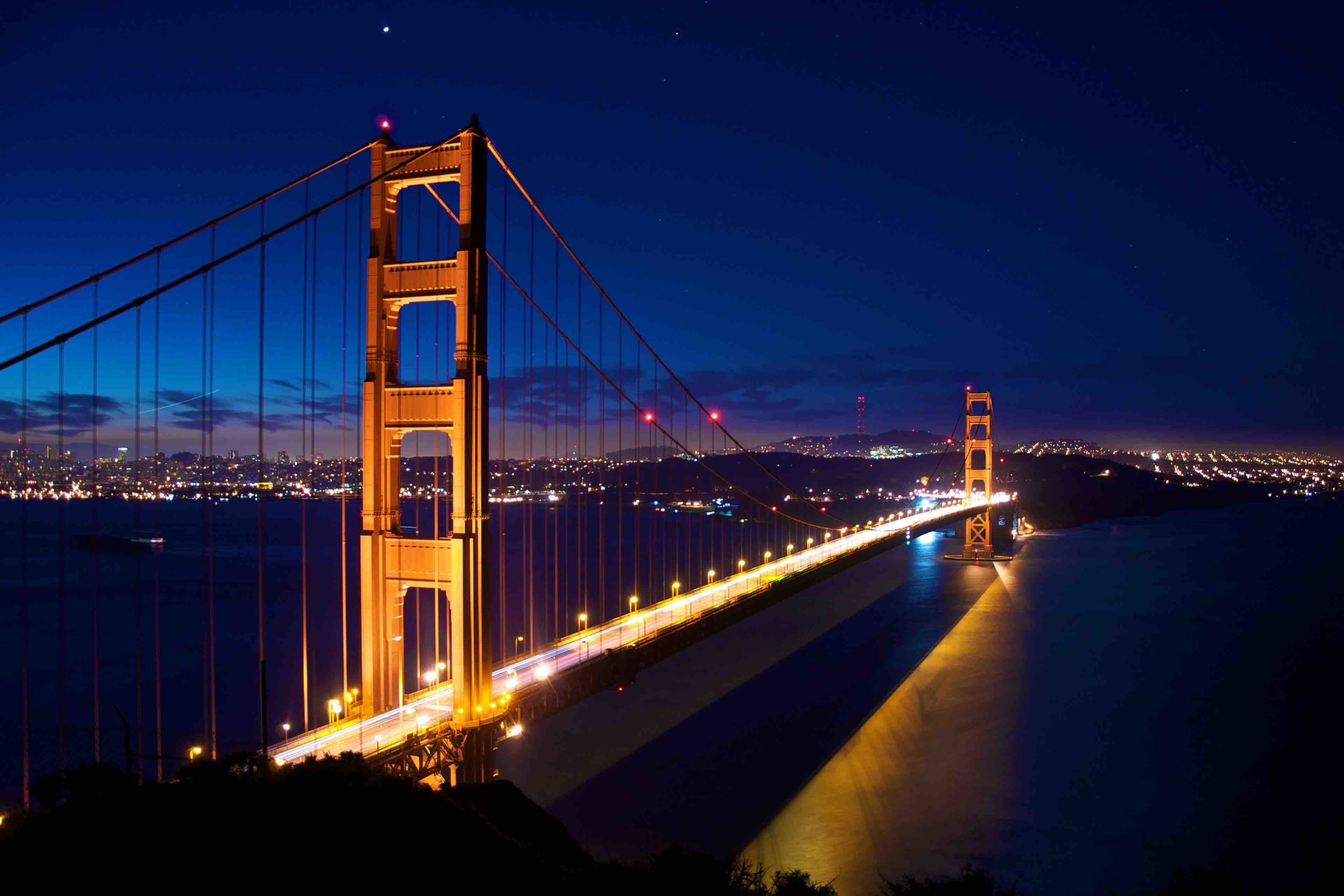 The Golden Gate is a strait on the west coast of North America that connects San Francisco Bay to the Pacific Ocean. It is defined by the headlands of the San Francisco Peninsula and the Marin Peninsula, and, since 1937, has been spanned by the Golden Gate Bridge.