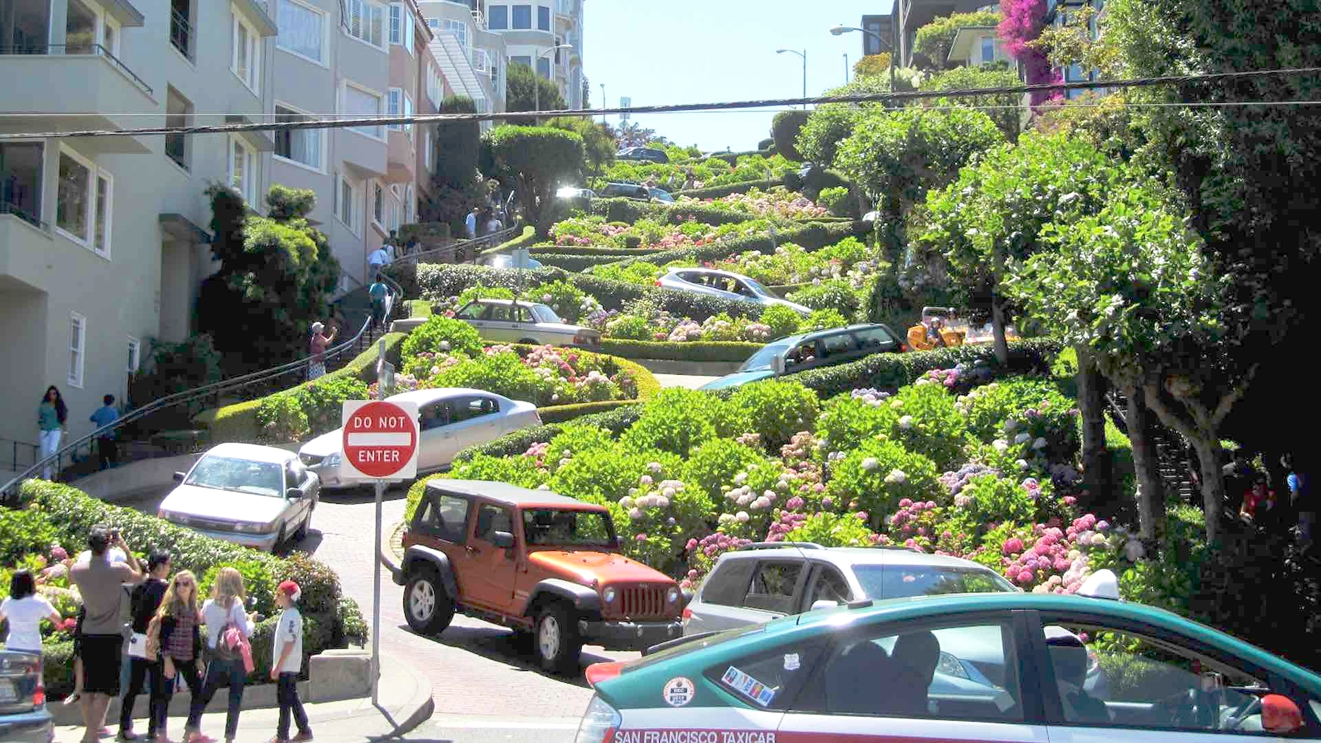 """Lombard Street is an east–west street in San Francisco, California that is famous for a steep, one-block section with eight hairpin turns. Stretching from The Presidio east to The Embarcadero (with a gap on Telegraph Hill), most of the street's western segment is a major thoroughfare designated as part of U.S. Route 101. The famous one-block section, claimed as """"the most crooked street in the world"""", is located along the eastern segment in the Russian Hill neighborhood. The street was named after Lombard Street in Philadelphia by San Francisco surveyor Jasper O'Farrell."""