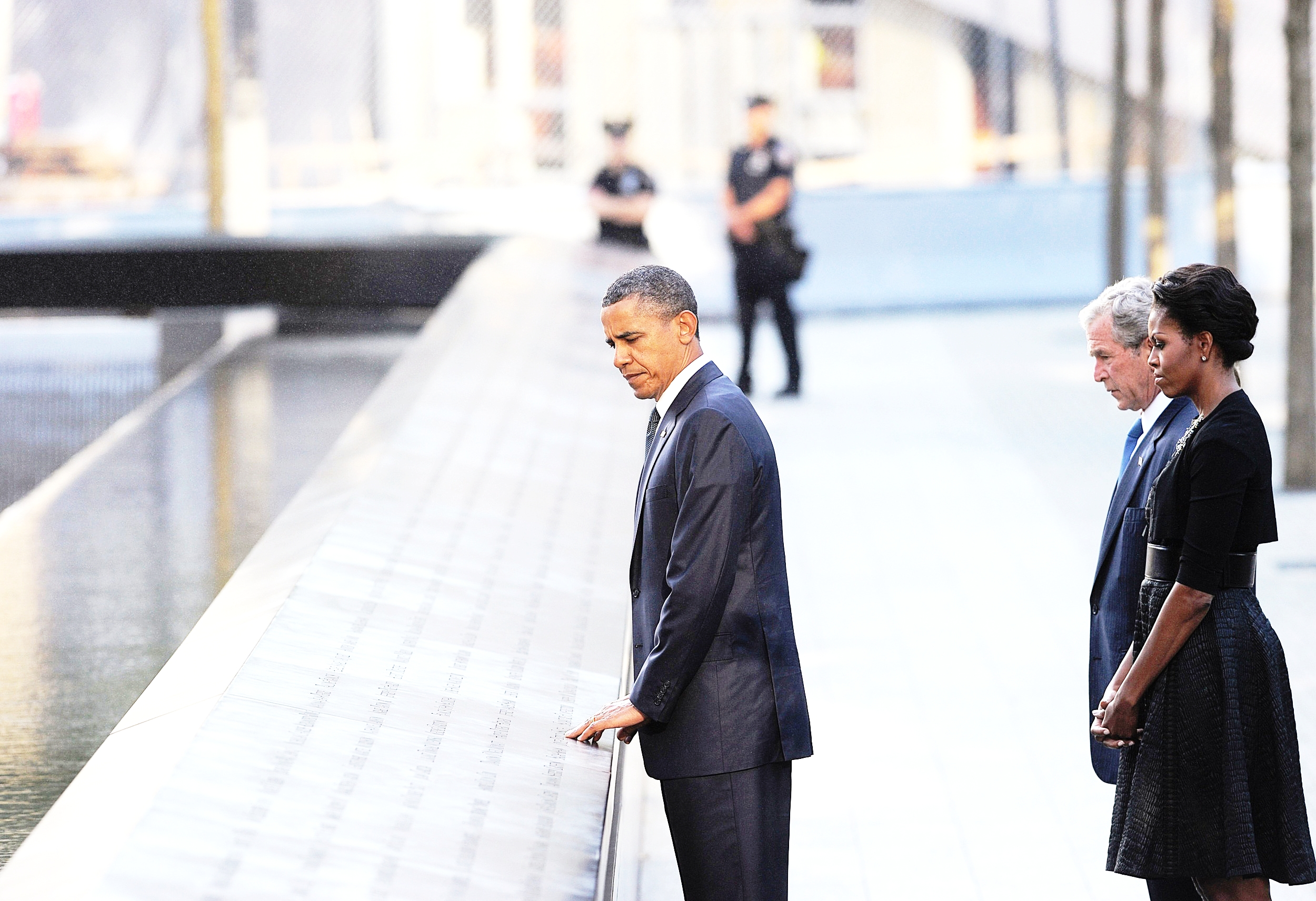 President Barack Obama, Michelle Obama, and President George W. Bush at the 9/11 National Memorial in Lower Manhattan