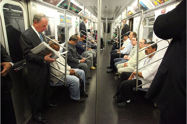 """New York City Mayor Michael Bloomberg reads one of his newspapers during his subway ride to City Hall in this file photo taken in 2002.He is public transportation's loudest cheerleader, boasting that he takes the subway """"virtually every day."""" He has told residents who complain about overcrowded trains to """"get real"""" and he constantly encourages New Yorkers to follow his environmentally friendly example.Bloomberg has said that he is energized by the city's tough fiscal times and in fact that he probably wouldn't even want to govern a prosperous city. (AP Photo/Richard Drew)"""