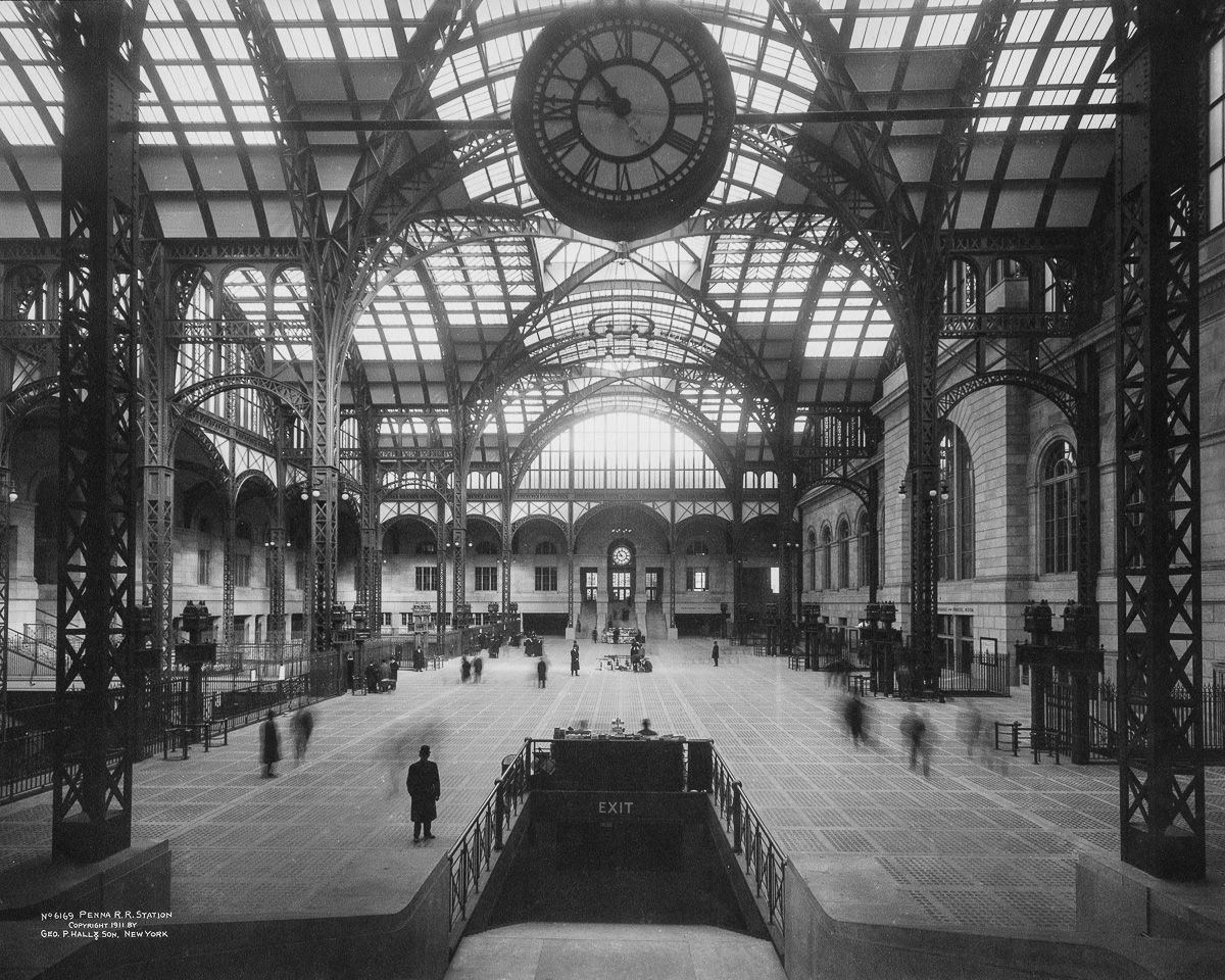 The original Pennsylvania Station was built from 1901-1910 by the Pennsylvania Railroad and featured an ornate marble and granite station house and train shed inspired by the Gare d'Orsay in Paris (the world's first electrified rail terminal). After a decline in passenger usage during the 1950s, the original station was demolished and reconstructed from 1963 to 1969, resulting in the current station. Future plans for Penn Station include the Gateway Project and the possibility of shifting some trains to the adjacent Farley Post Office, a building designed by the same architects as the original 1910 station.