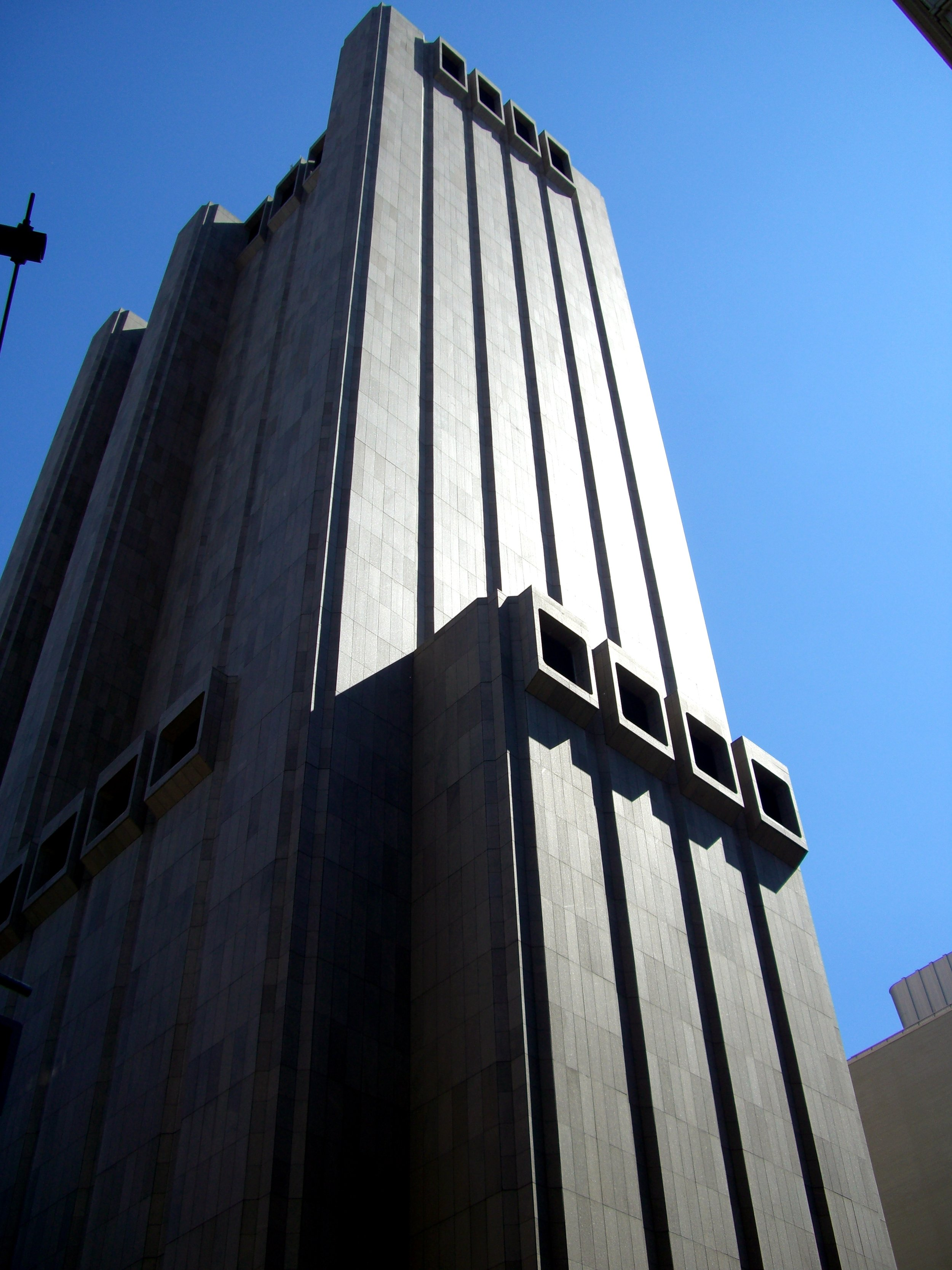 The former AT&T Long Lines Building at 33 Thomas Street is a 550-foot (167.5 meters) tall skyscraper in the Borough of Manhattan, New York, United States. It stands on the east side of Church Street, between Thomas and Worth Streets.  The building is a telephone exchange or wire center building which contained three major switches used for interexchange (long distance) telephony, two owned by AT&T and one formerly owned by Verizon (decommissioned in 2009). The building is reportedly home to a National Security Agency surveillance facility named TITANPOINTE.