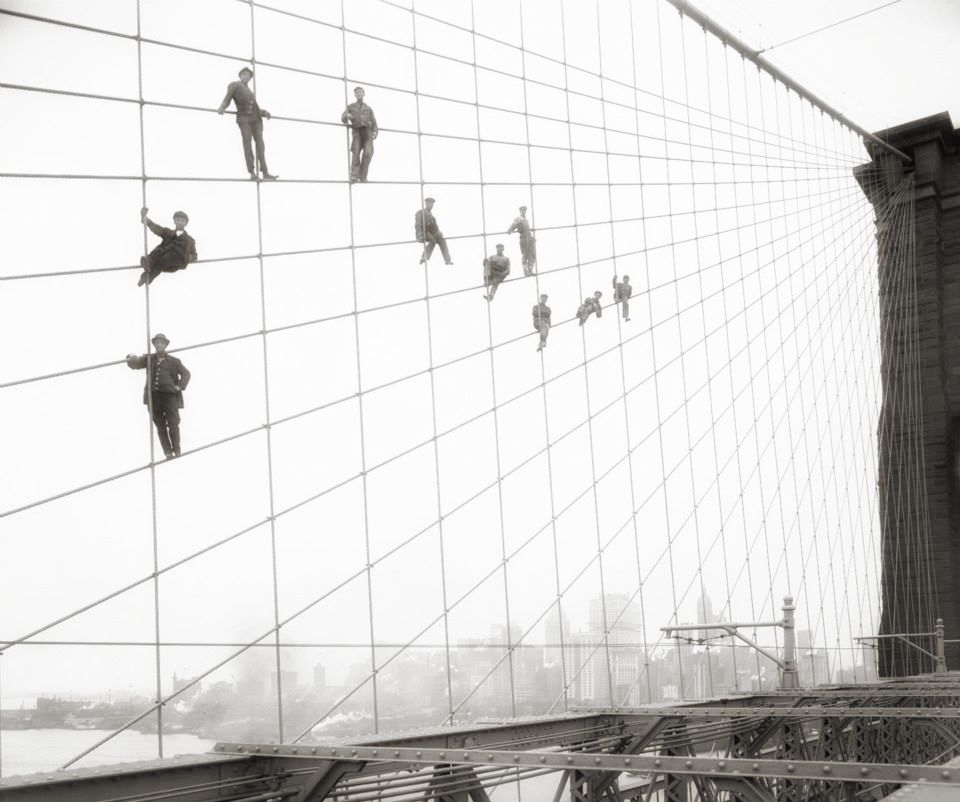"""Workers at the    Brooklyn Bridge    ( 1914). The Brooklyn Bridge opened to the public on May 24, 1883, thereby connecting Manhattan with Brooklyn for the first time. Dubbed the """"Eighth Wonder of the World,"""" early visitors gawked at its immense granite towers and thick steel cables, not to mention its birds-eye views. The bridge, which took 14 years and around $15 million to complete, remains among New York City's top tourist attractions and a busy thoroughfare for commuters.Brooklyn did not become part of New York City until 1898, following a referendum that passed there by just 277 votes (out of more than 129,000 cast). 
