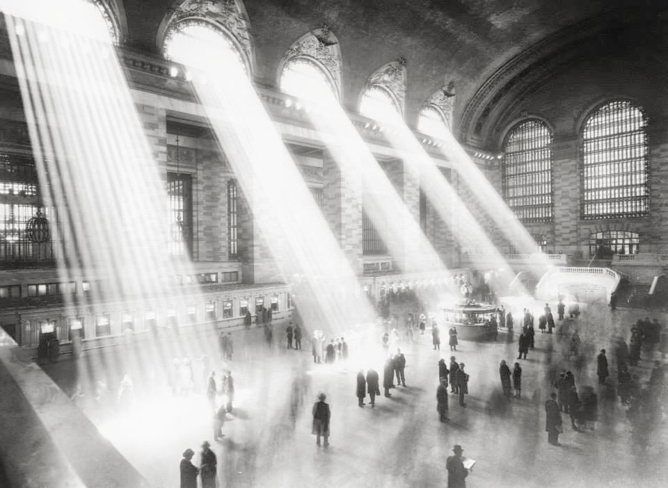 """Grand Central Terminal    main concourse (1923). The smoke inside is from cigarettes. At some point, the ceiling completely covered with a dark patch. It was formed by over 100 years of dirt and,mostly, the result of decades of smoking in the terminal. MTA's Marjorie Anders explains:  """"The remaining dirt is a combination of tarry nicotine from the millions of cigarettes, cigars and pipes once consumed in the Terminal by generations of travelers and the soot and steel dust that stuck to it. Smoking was banned in Grand Central Terminal in March 30, 2003, the same time the ban went into effect citywide.""""  