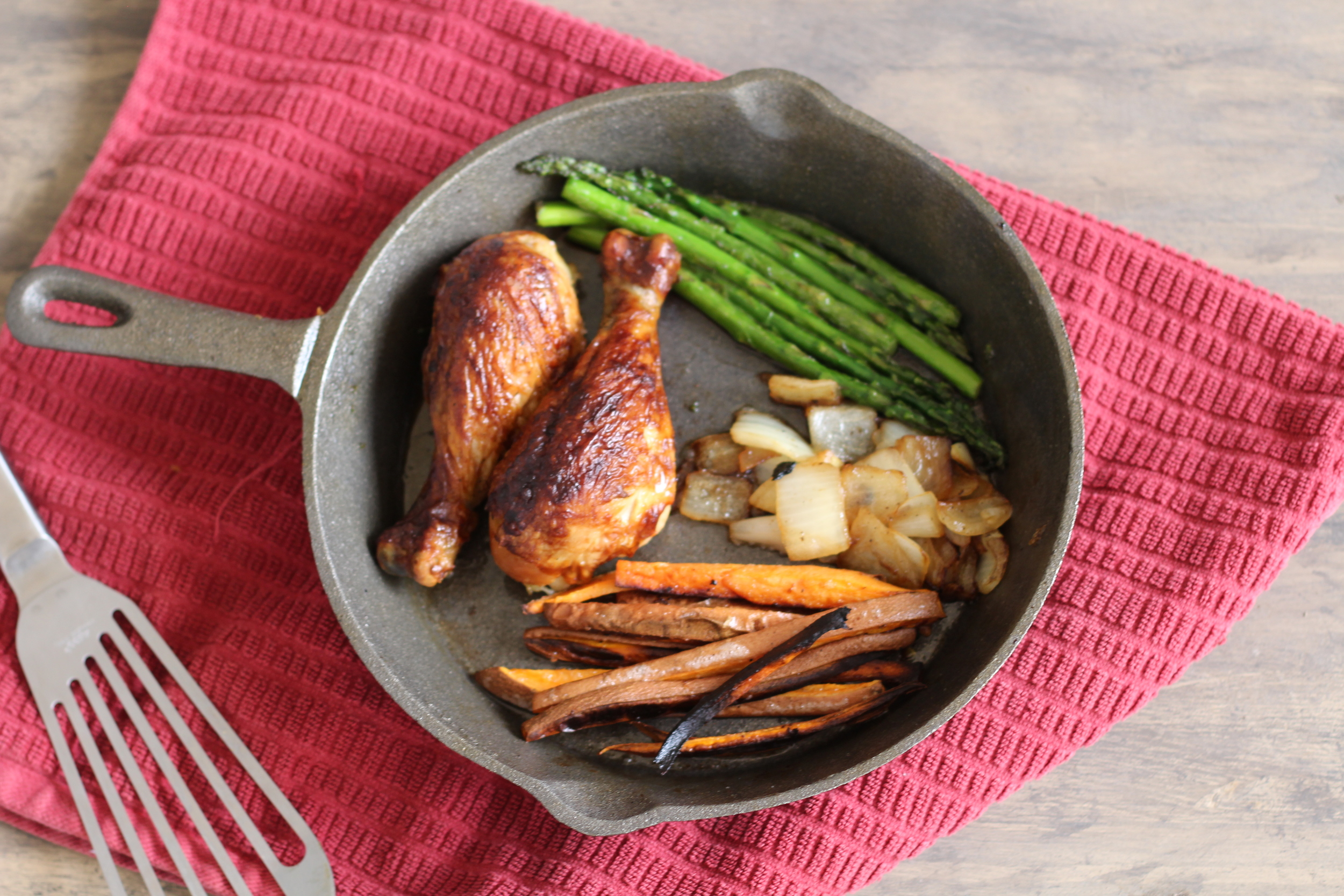 Delicious may i SAY! Dinner! Chicken legs, sweet potato fries (Obsessed) onions and asparagus!