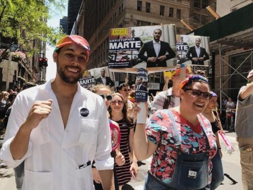 Mr. Marte walking during Pride.