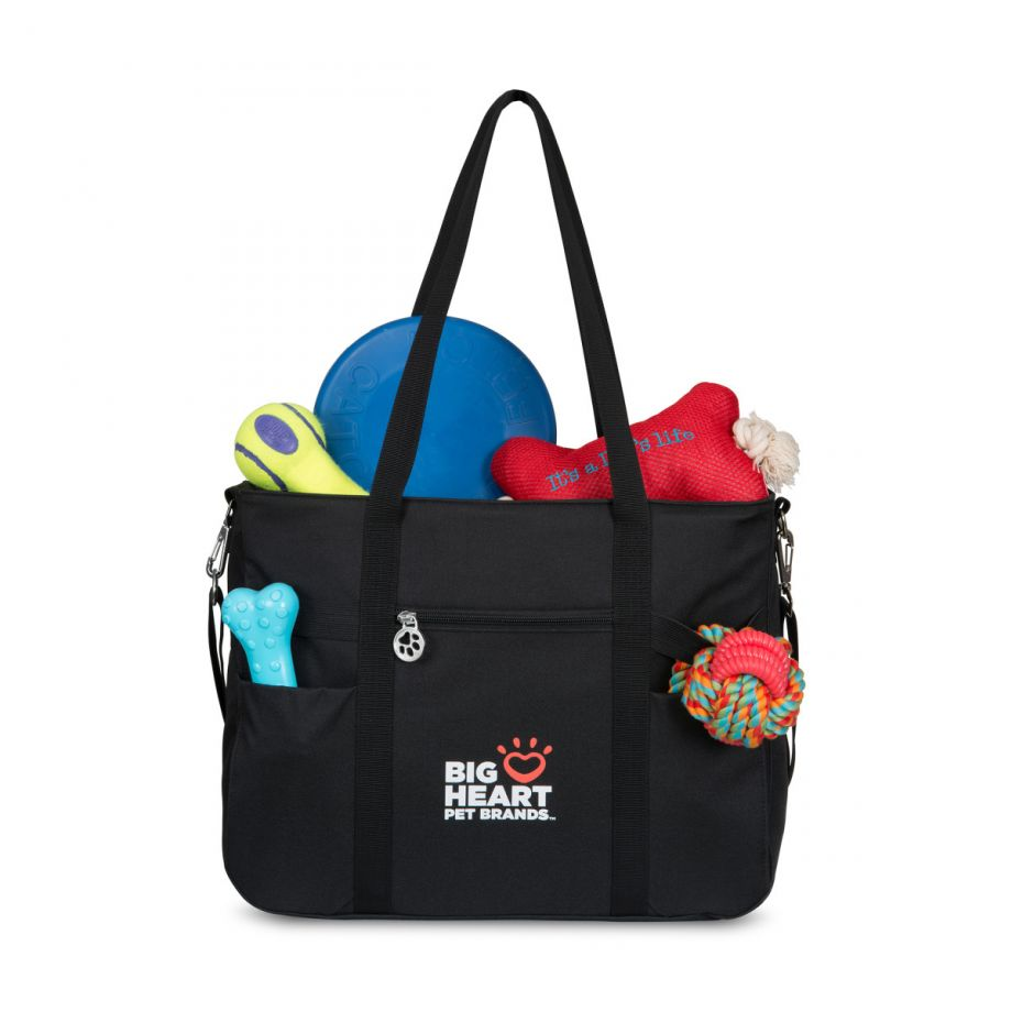 Front pockets have a secondary elastic closure to hold larger pet toys securely.