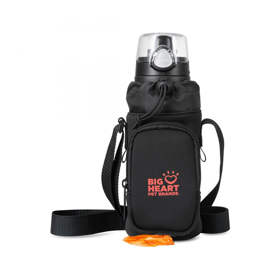 The front pocket features a port to quickly access dog waste bags.