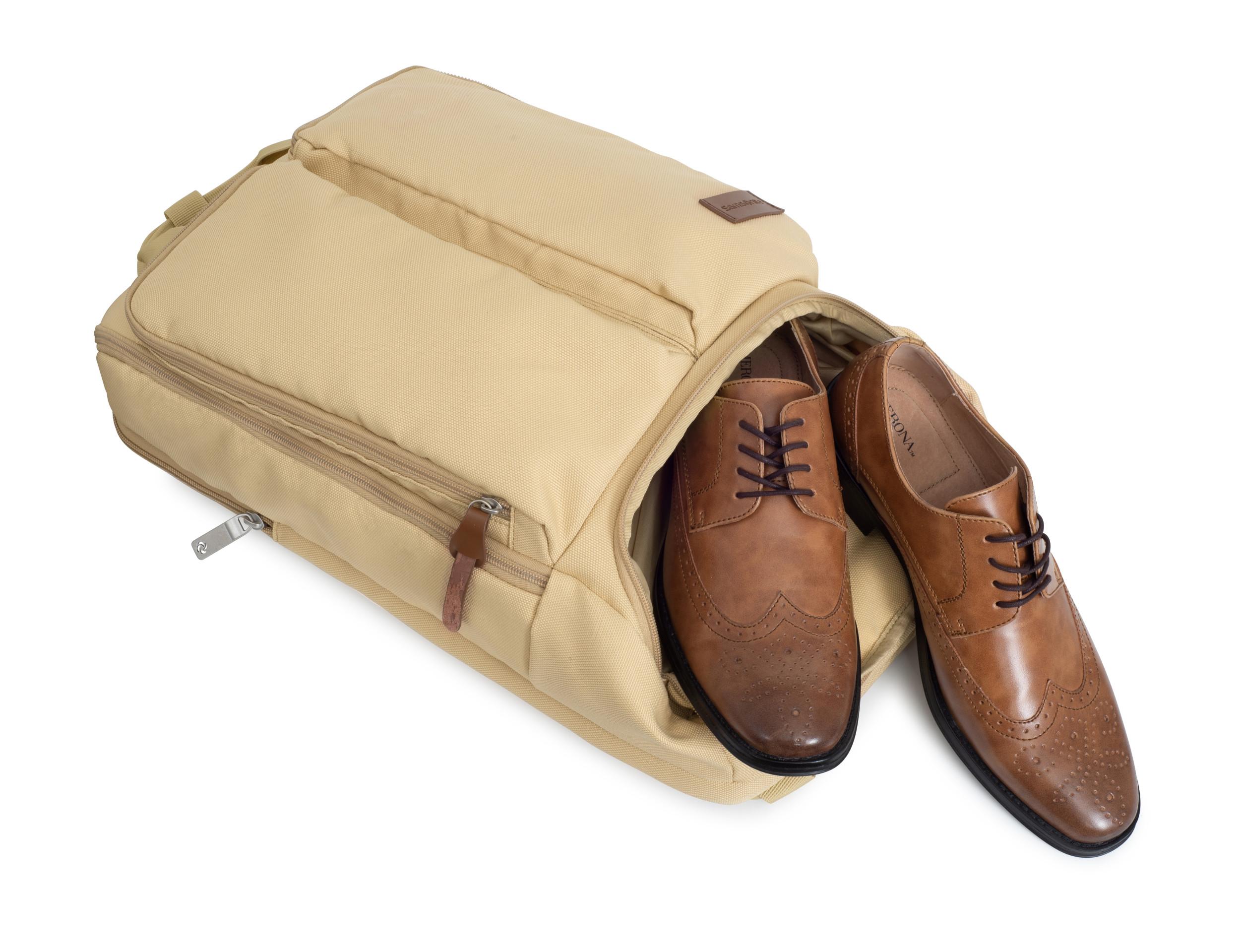 Cargo pockets for exterior organization, integrated shoe pocket, and interior organization. Top grab handles for an alternative carry option.