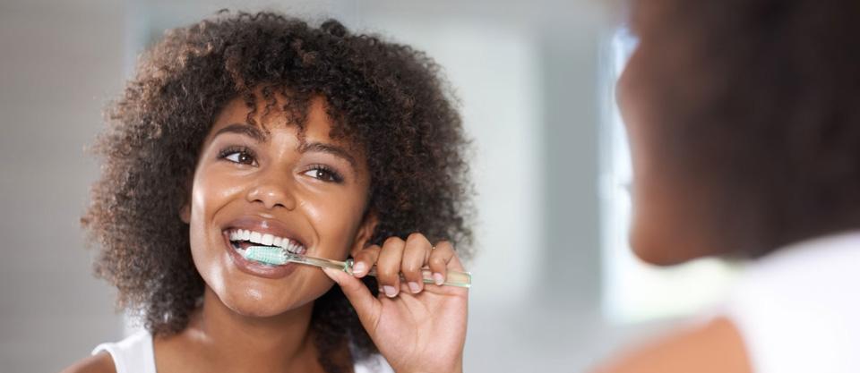 Women Brushing Teeth