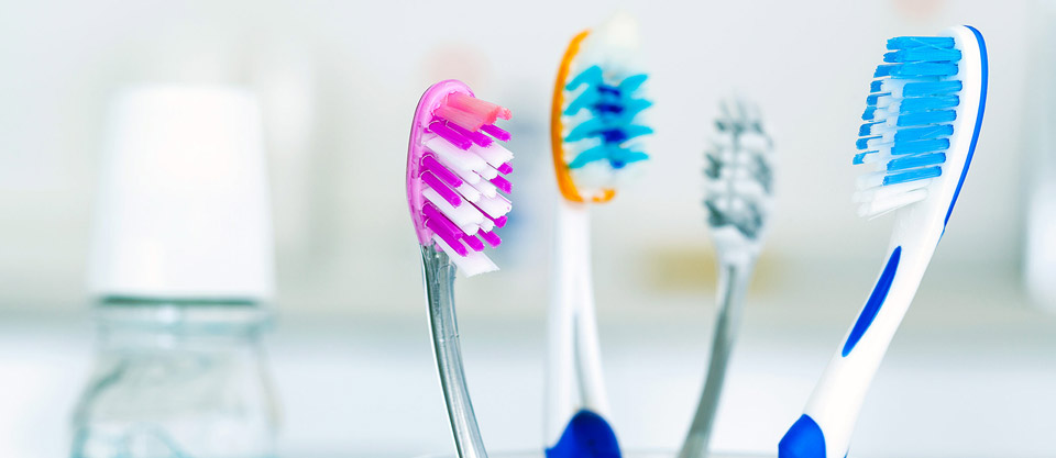 Toothbrushes near sink