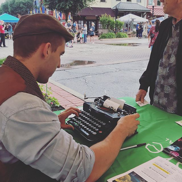 That time @rentpoet & @nayelipoet ended up at a Farmer's Market in Bentonville, AR weathering the elements! Luckily we had @waltonartscenter keeping us dry :) #spilledink #typewriter #typewriterpoet #typewriterpoetry #arkansas #bentonville #rain
