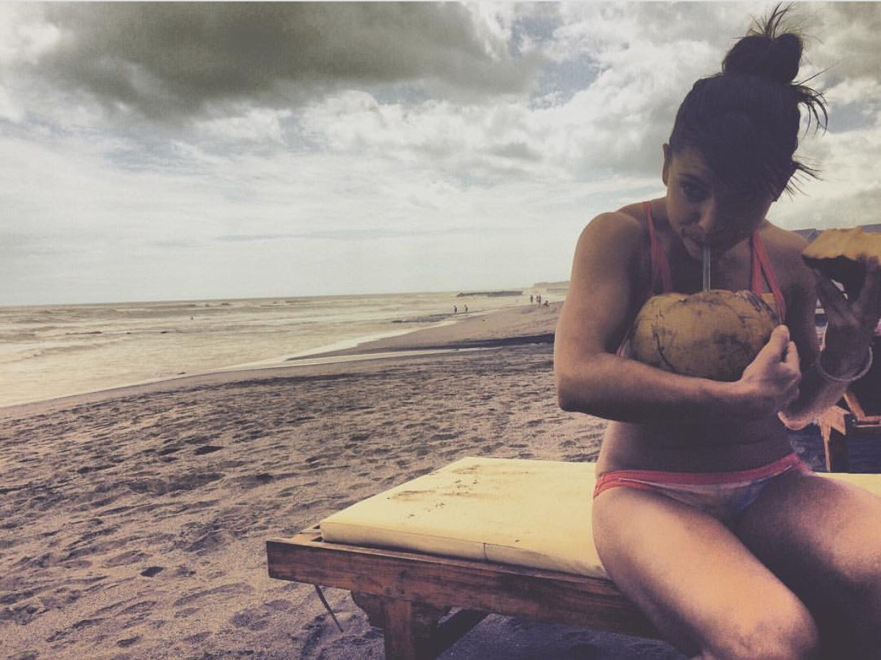Essential job quitting environment: Beach, coconuts, and a new old friend. Photo by  Lomicsa .