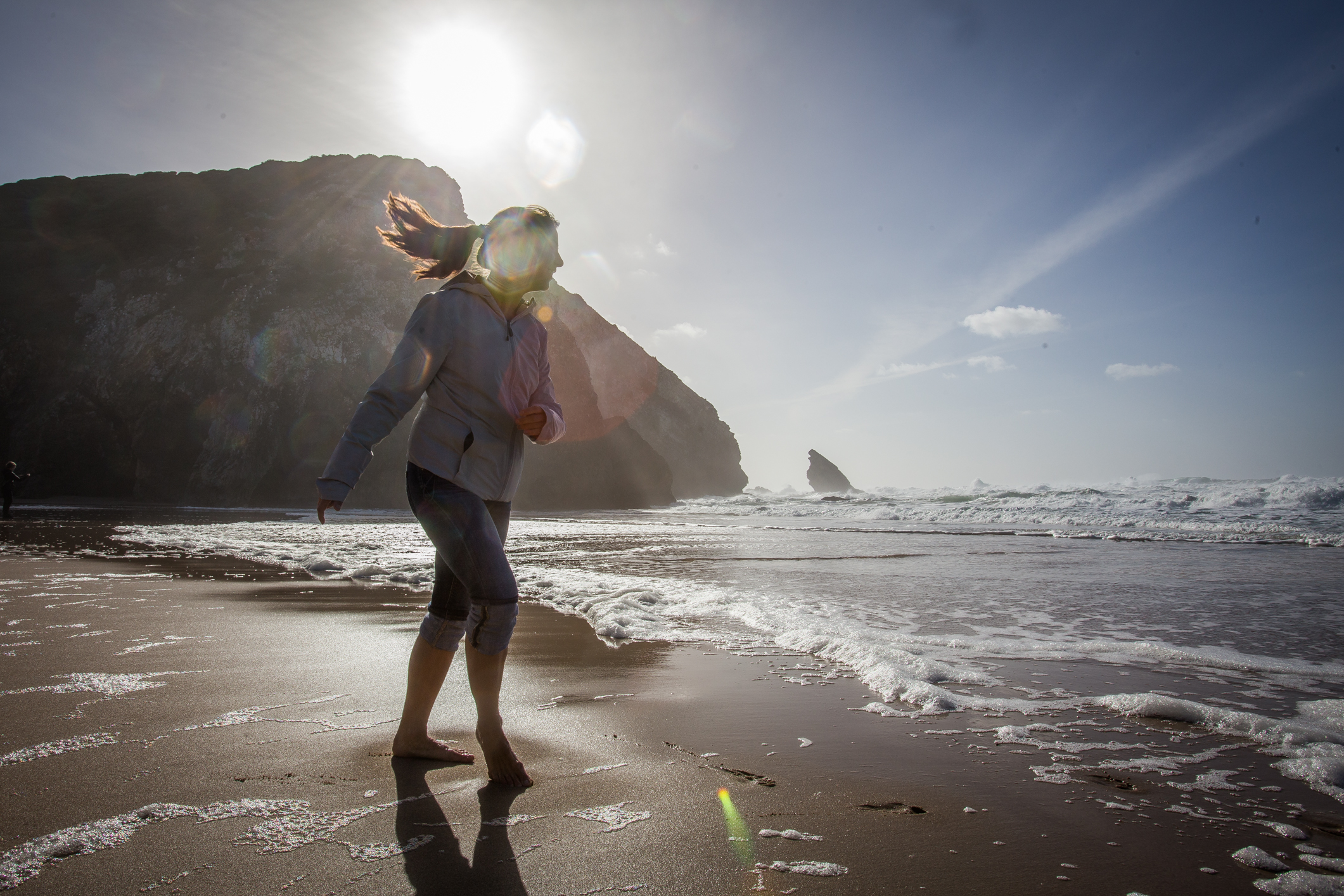 Barefoot in winter on the coast of Portugal.