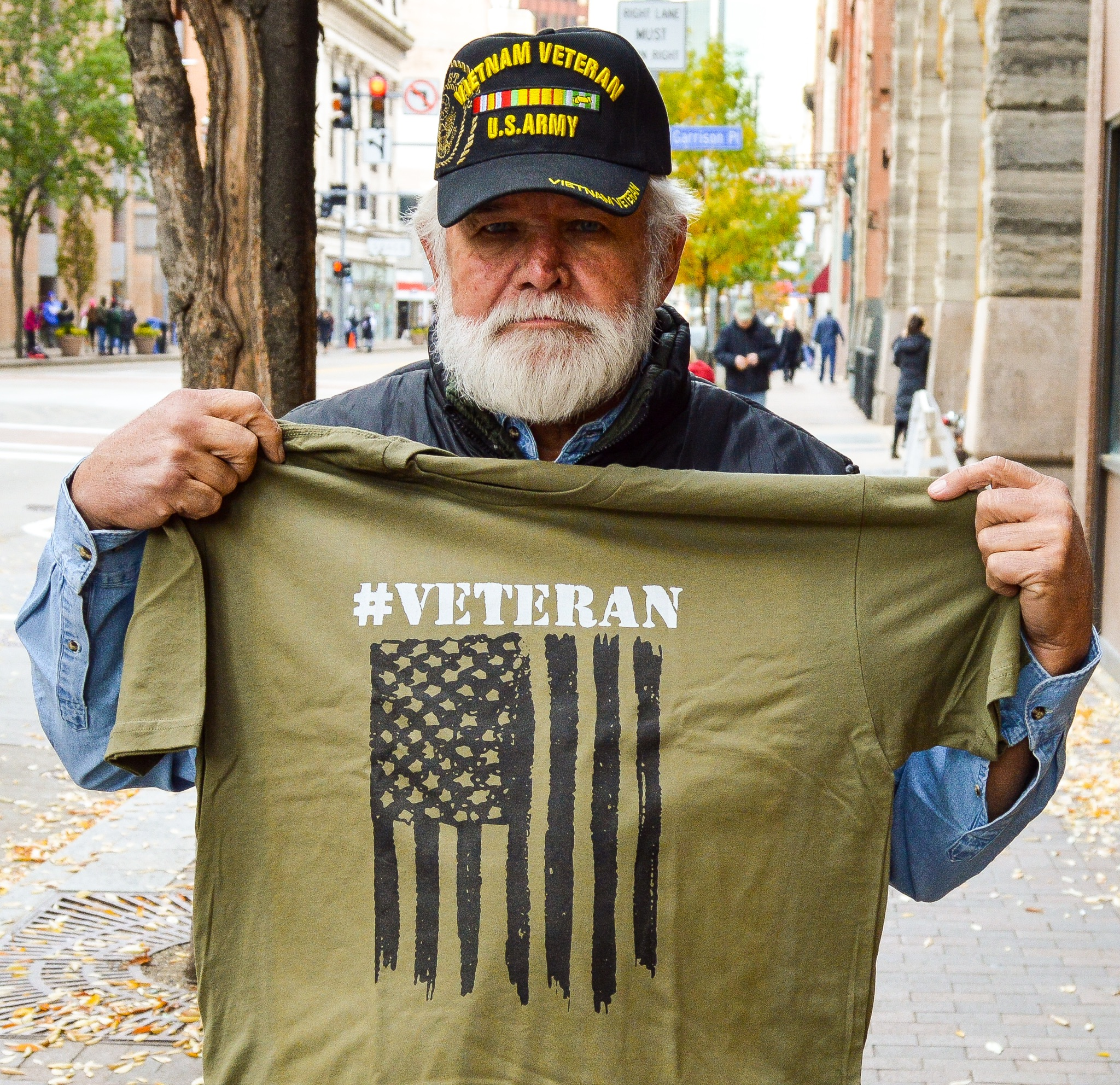 A silent and strong Veteran from the Pittsburgh Veteran's Day Parade with his new tee shirt.
