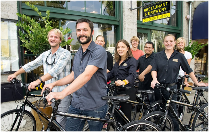 Employees of standing stone brewery with commuter bikes