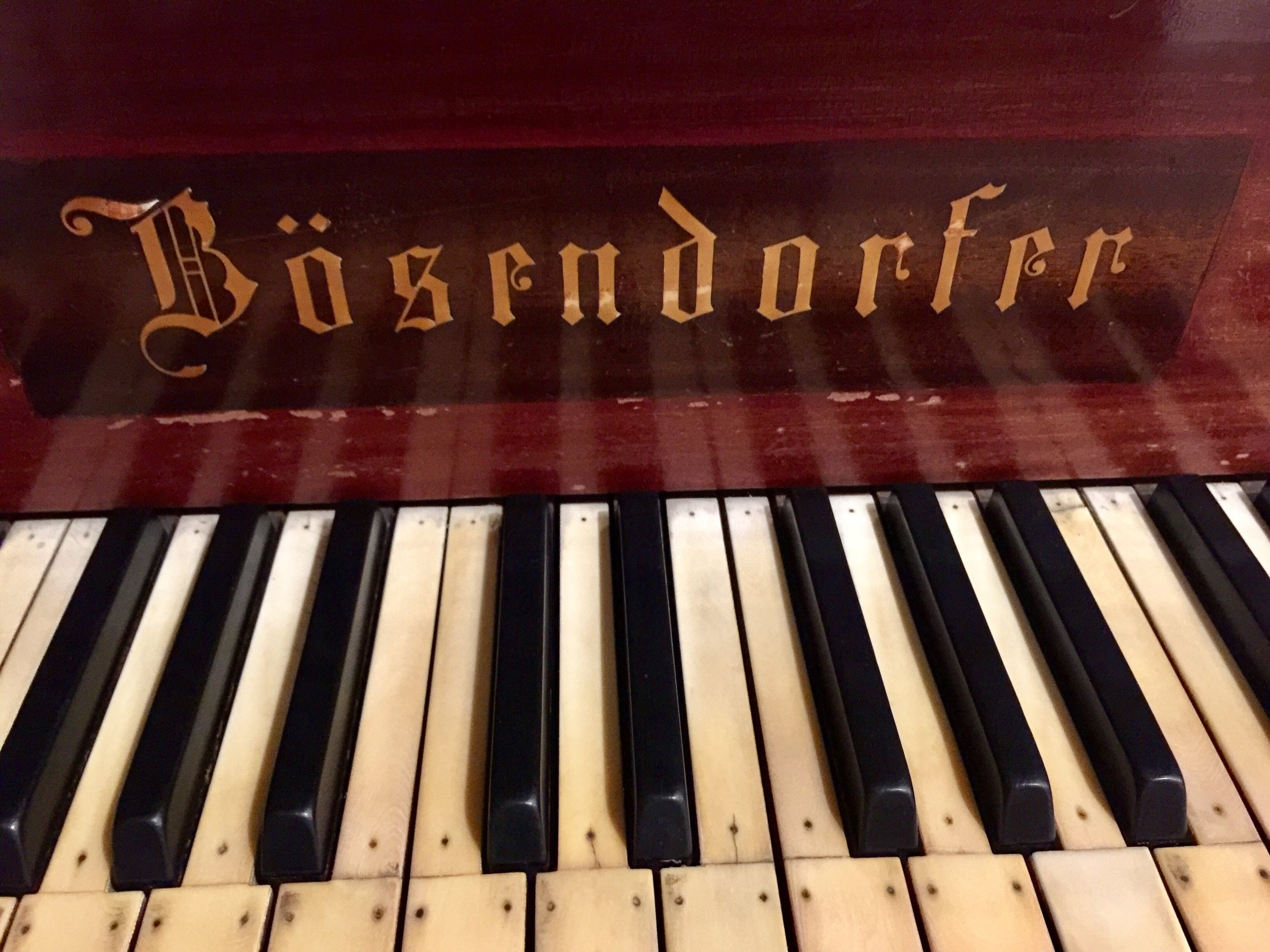 "A lovely Bõsendorfer piano owned by the Delhi Music Society. Ivory tops of keys nailed down due to humidity causing the glue to ""melt""."