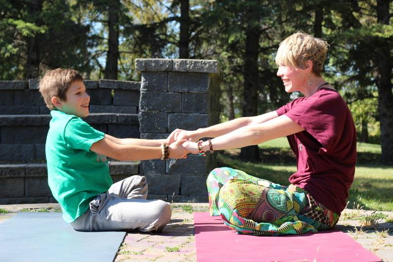 Seesaw is a partner pose that encourages social interaction and trust.