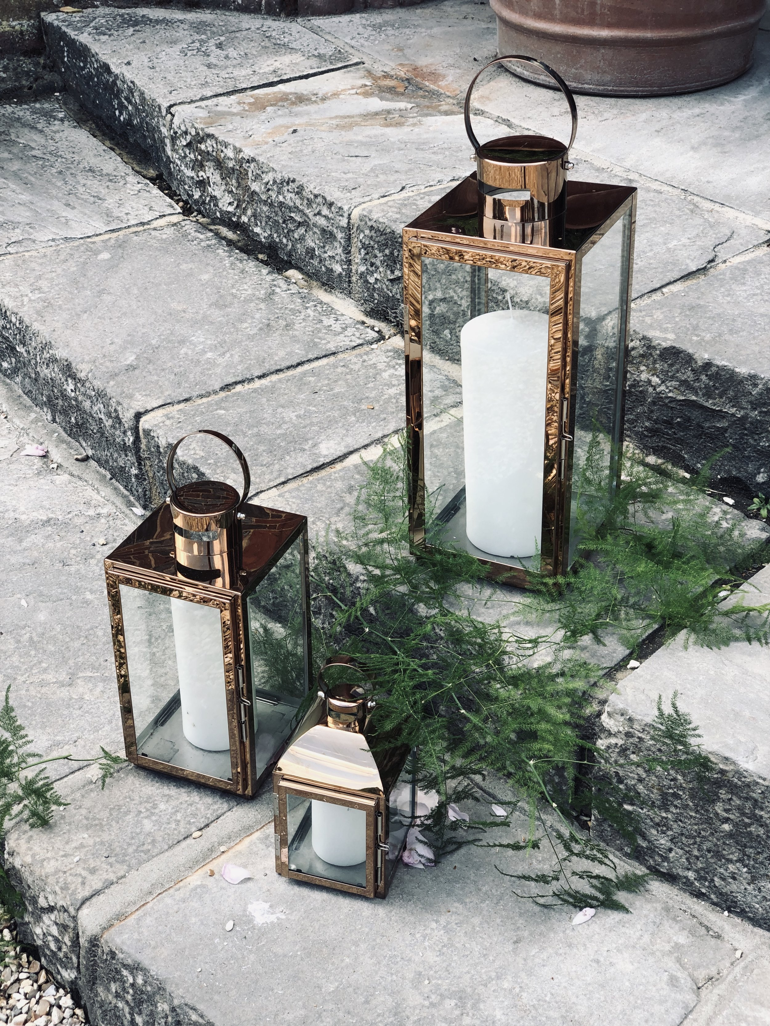 Copper Lanterns - This is the costing for Lanterns (and candles) only: Large: £15.00 EachMedium: £10.00Small: £5.00 eachI currently stock x3 Largex3 Medium and x3 SmallFoliage can be included on request.