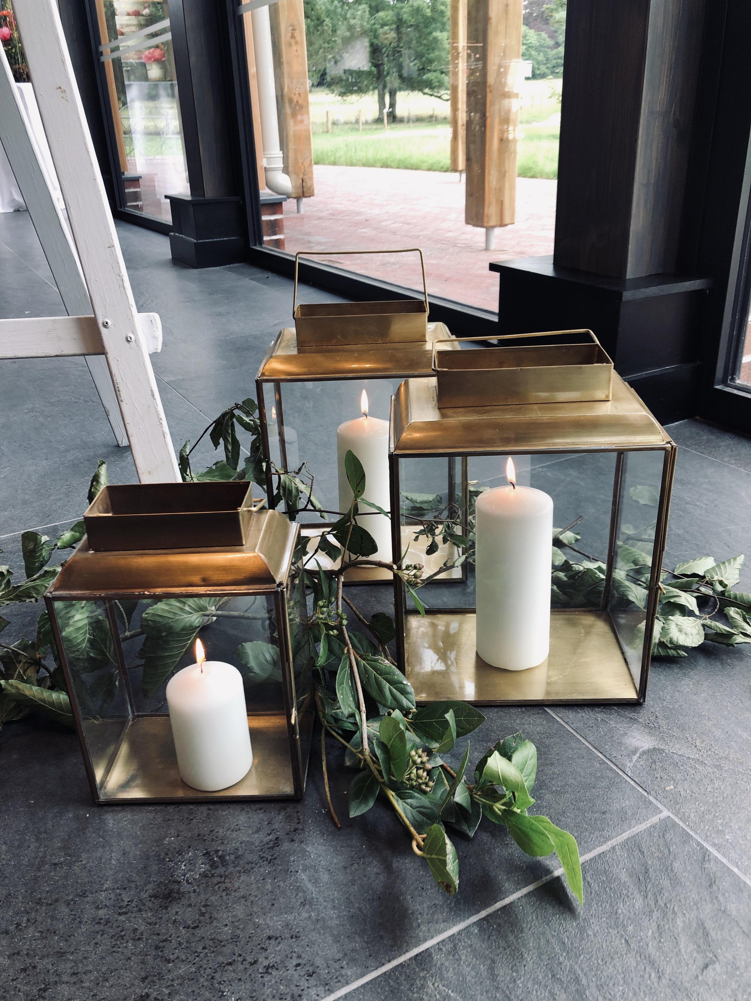 Nkuku Antique Brass Lanterns - Perfect for the Aisle or just to add a touch of romance to your wedding dayAvailable inLarge: £20.00 EachMedium: £15.00 EachI currently stock x4 Large and x4 Small. Candle includedFoliage can be included on request.