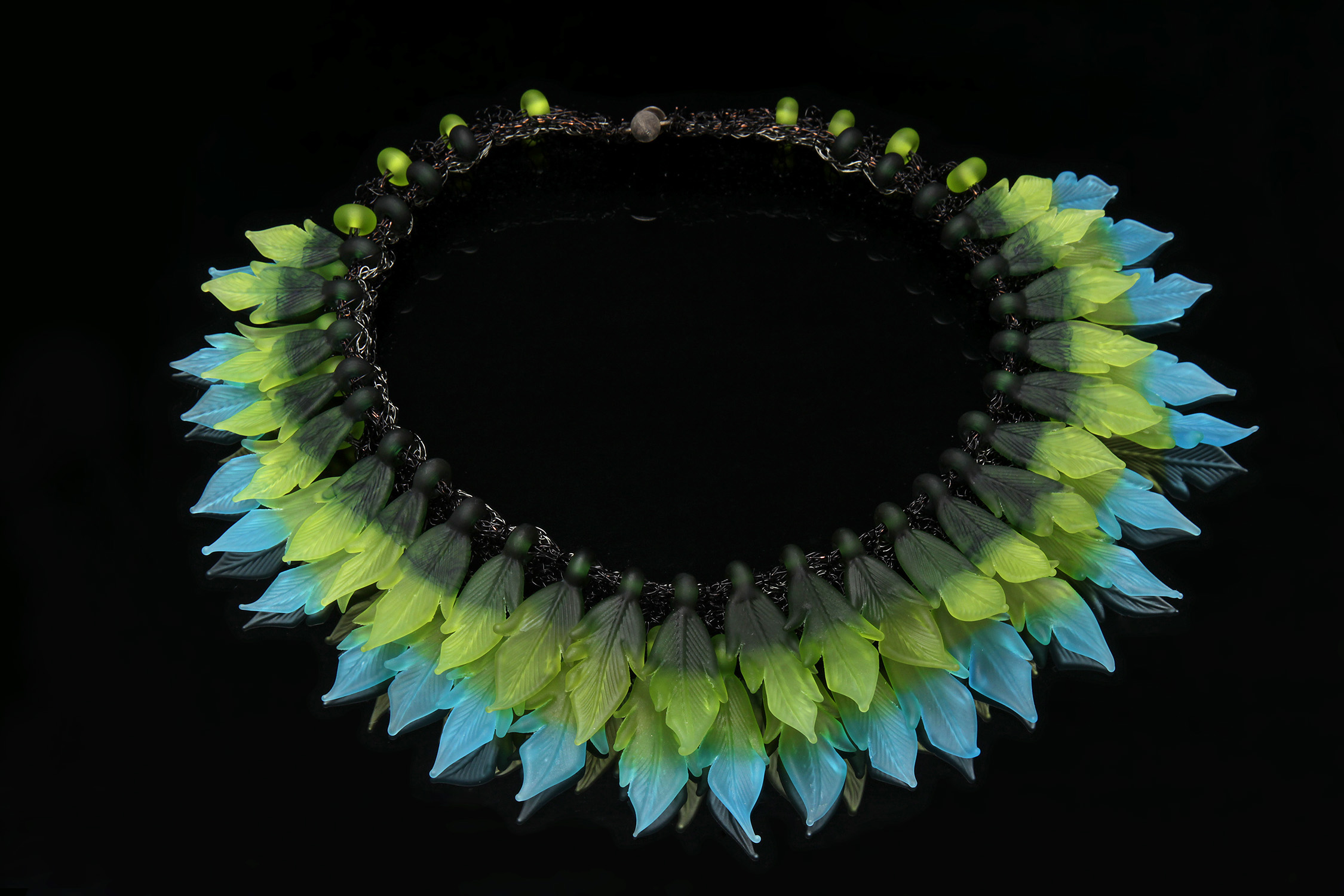 """""""Don't Ruffle My Feathers!"""" Glass leaves crocheted together with wire"""