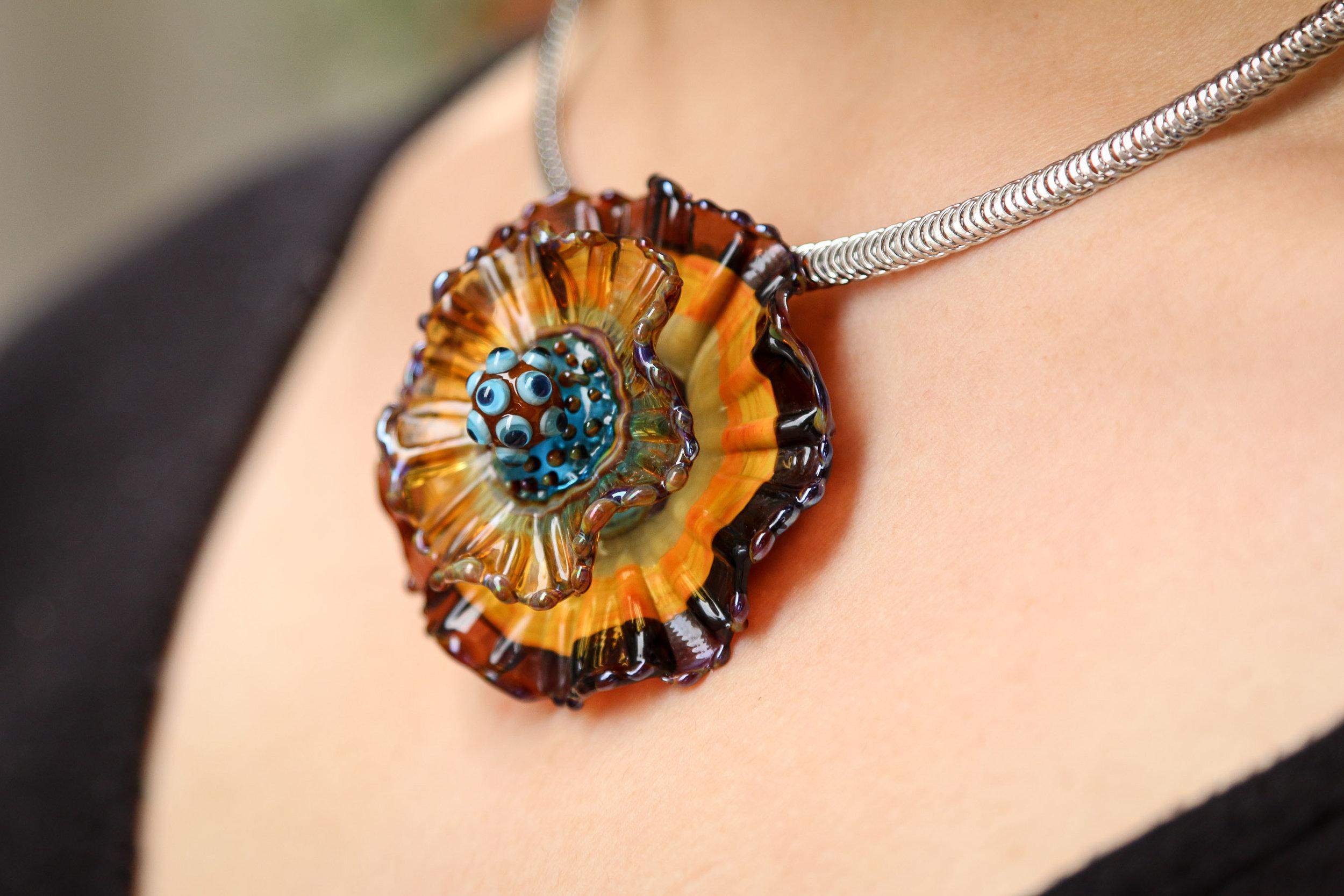 Dark Amber/orange/turquoise Anemone closeup