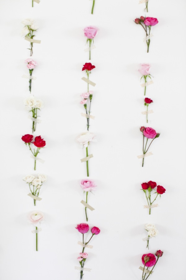 A fresh flower/washi tape wall, featured   here  at Style Me Pretty Living.