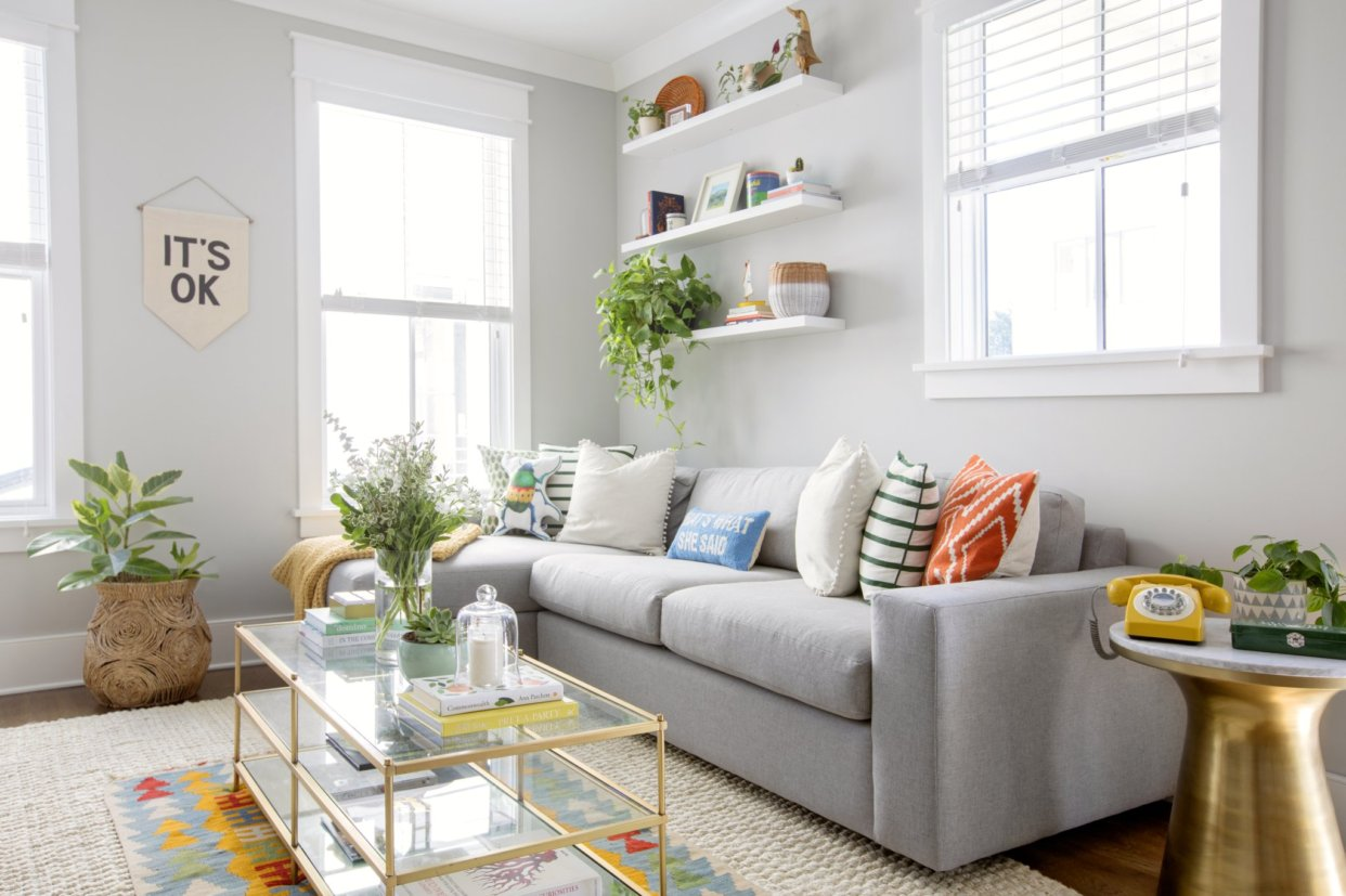 Colorful living room with grey couch
