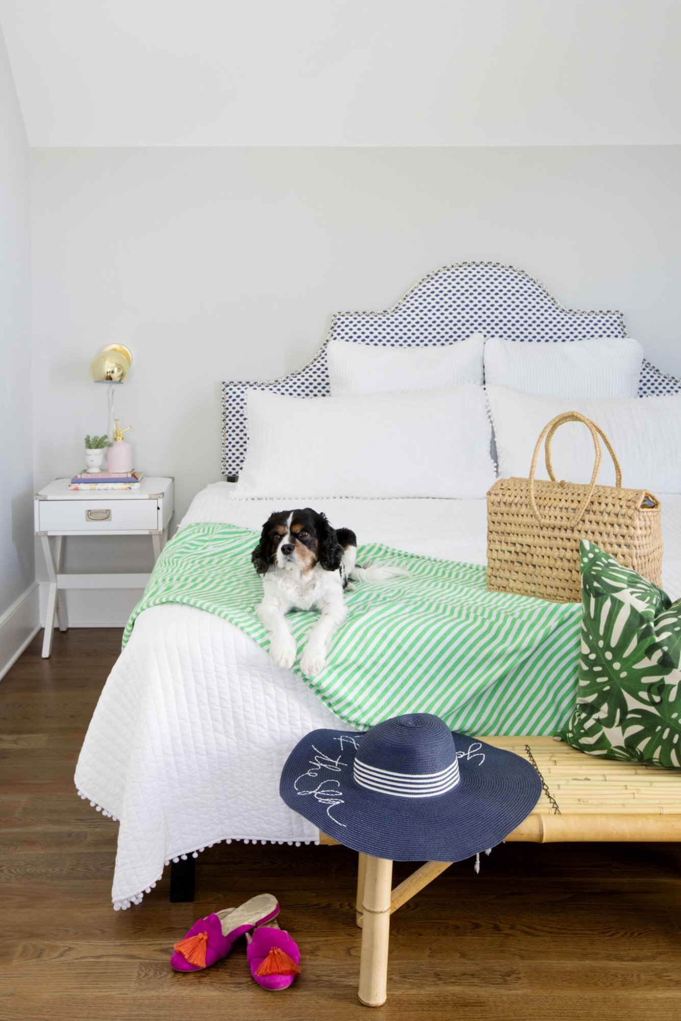 navy and green master bedroom with blue patterned headboard