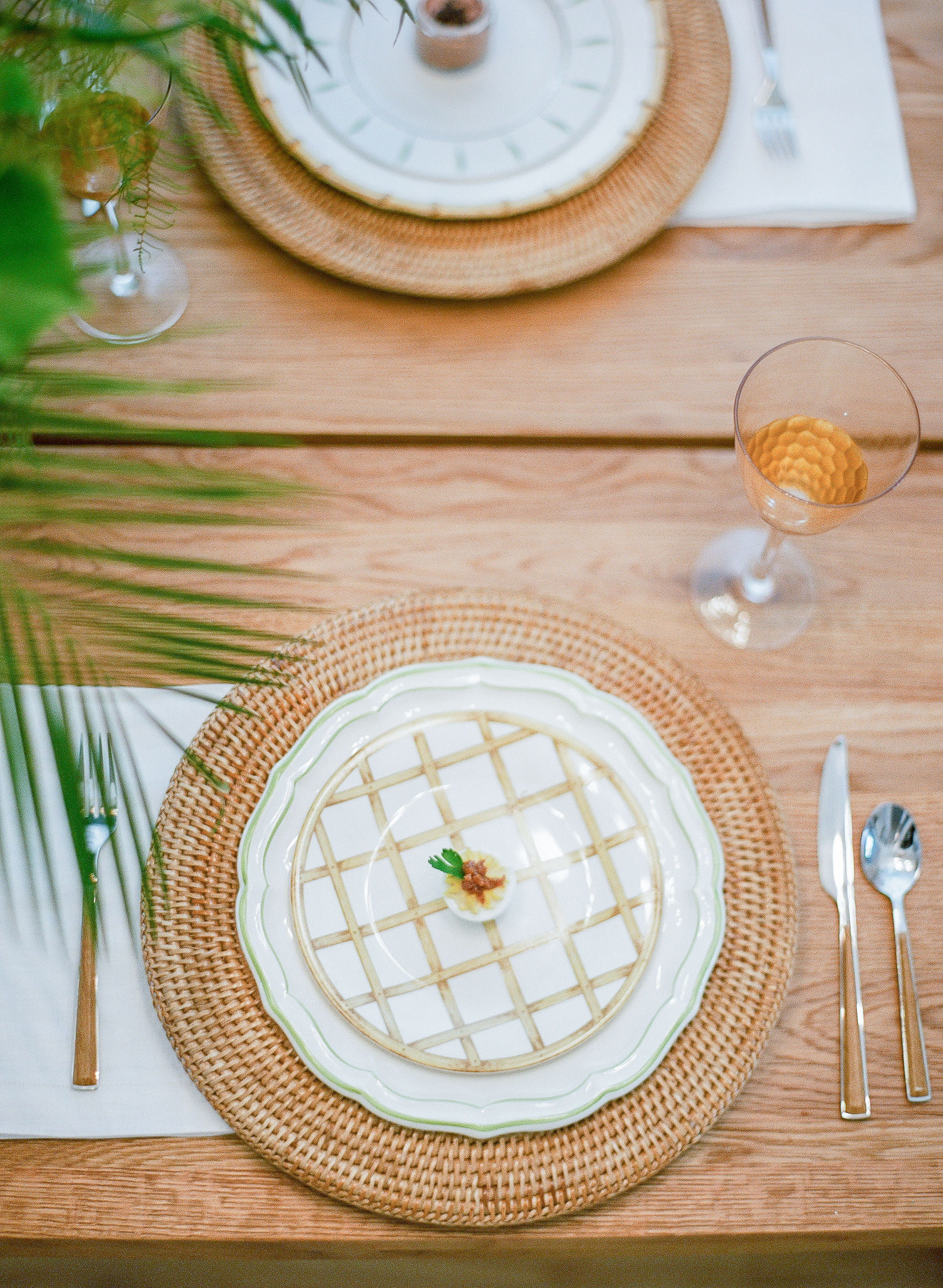 mix and match natural rattan and green place setting from Vieuxtemps in Charleston SC