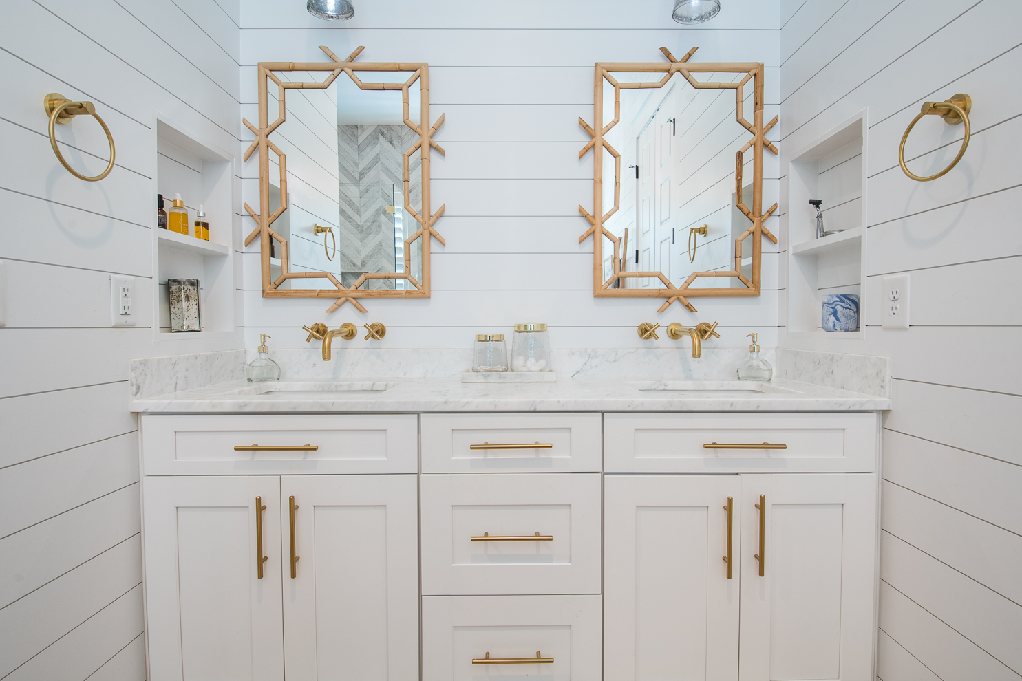 white bathroom with rattan accents
