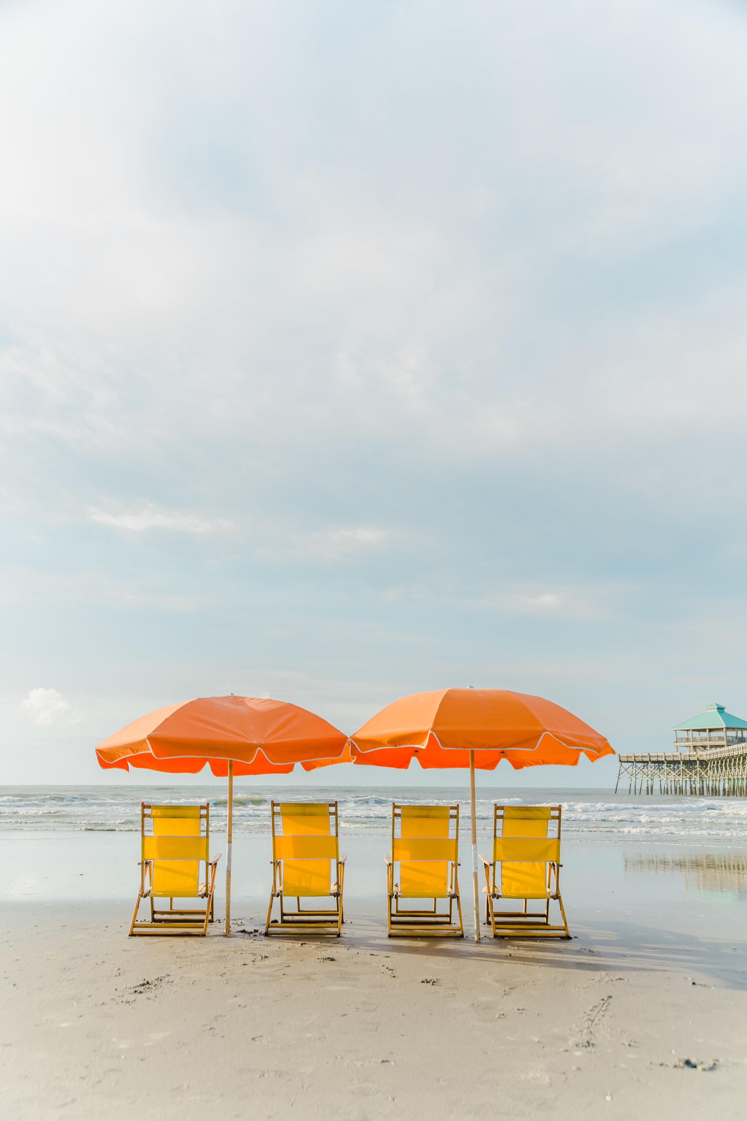 folly beach chair company | orange umbrellas on folly beach