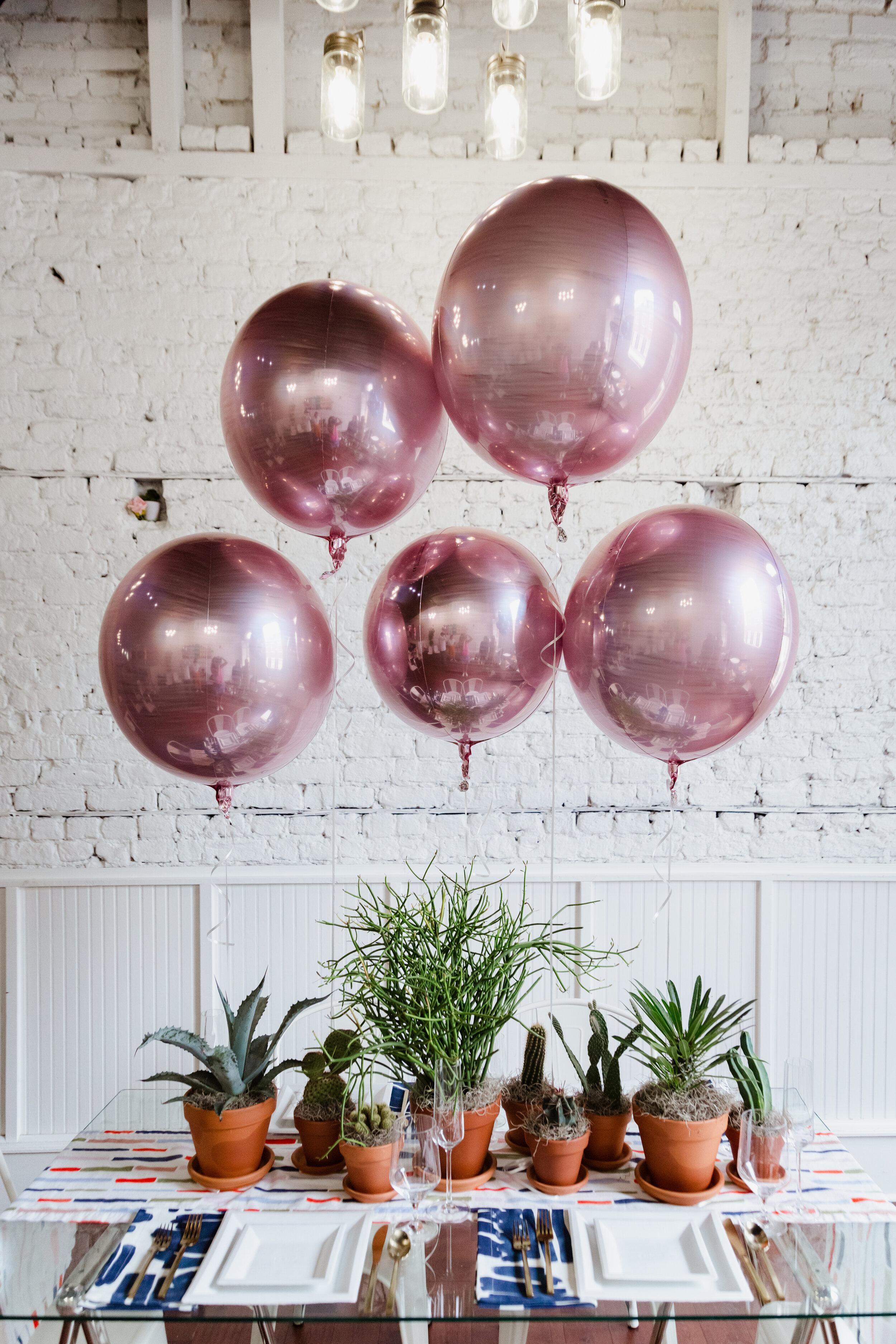 rose gold orbz from Anagram balloons for Charleston Friendsgiving