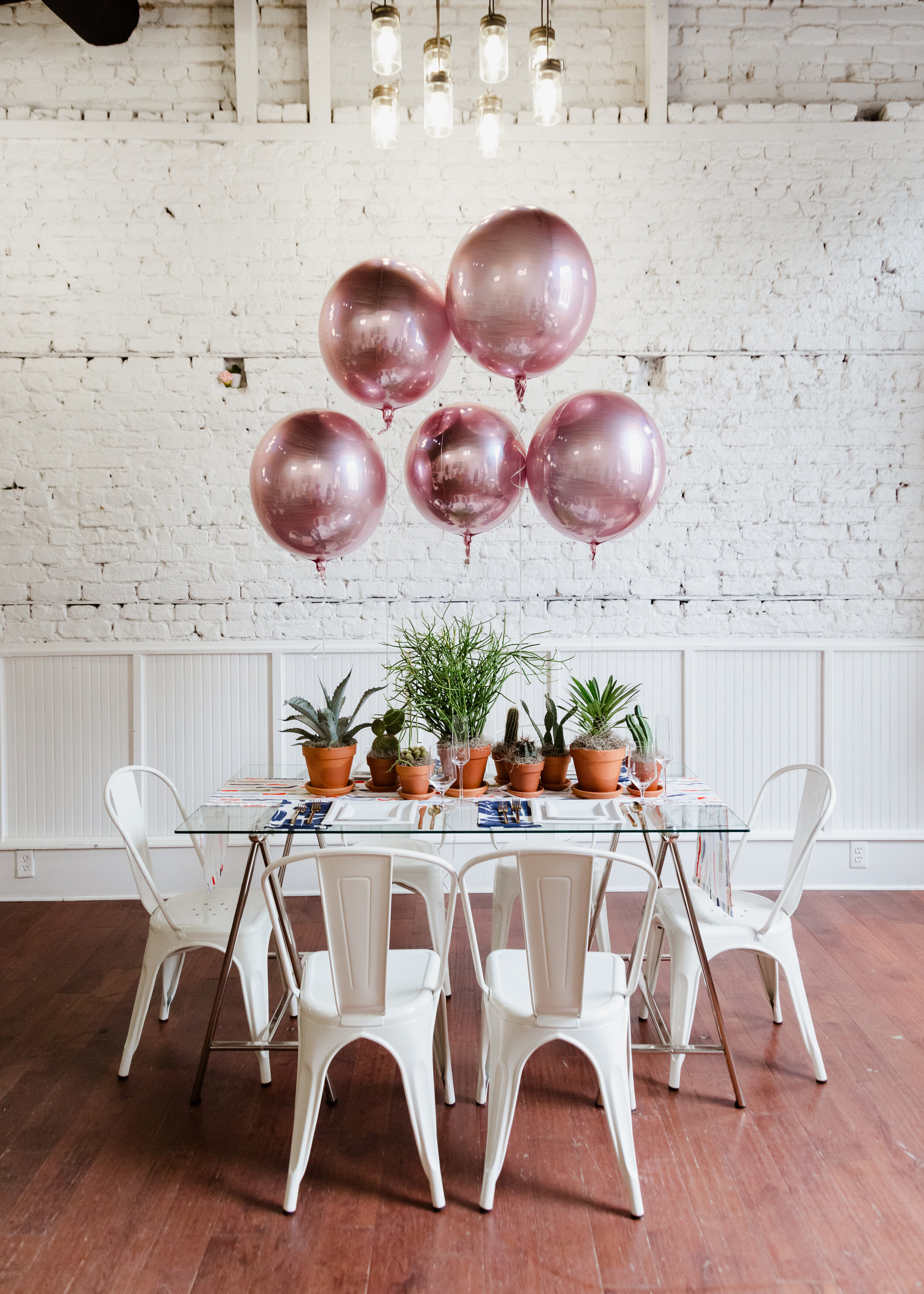 Friendsgiving tablescape with rose gold balloons