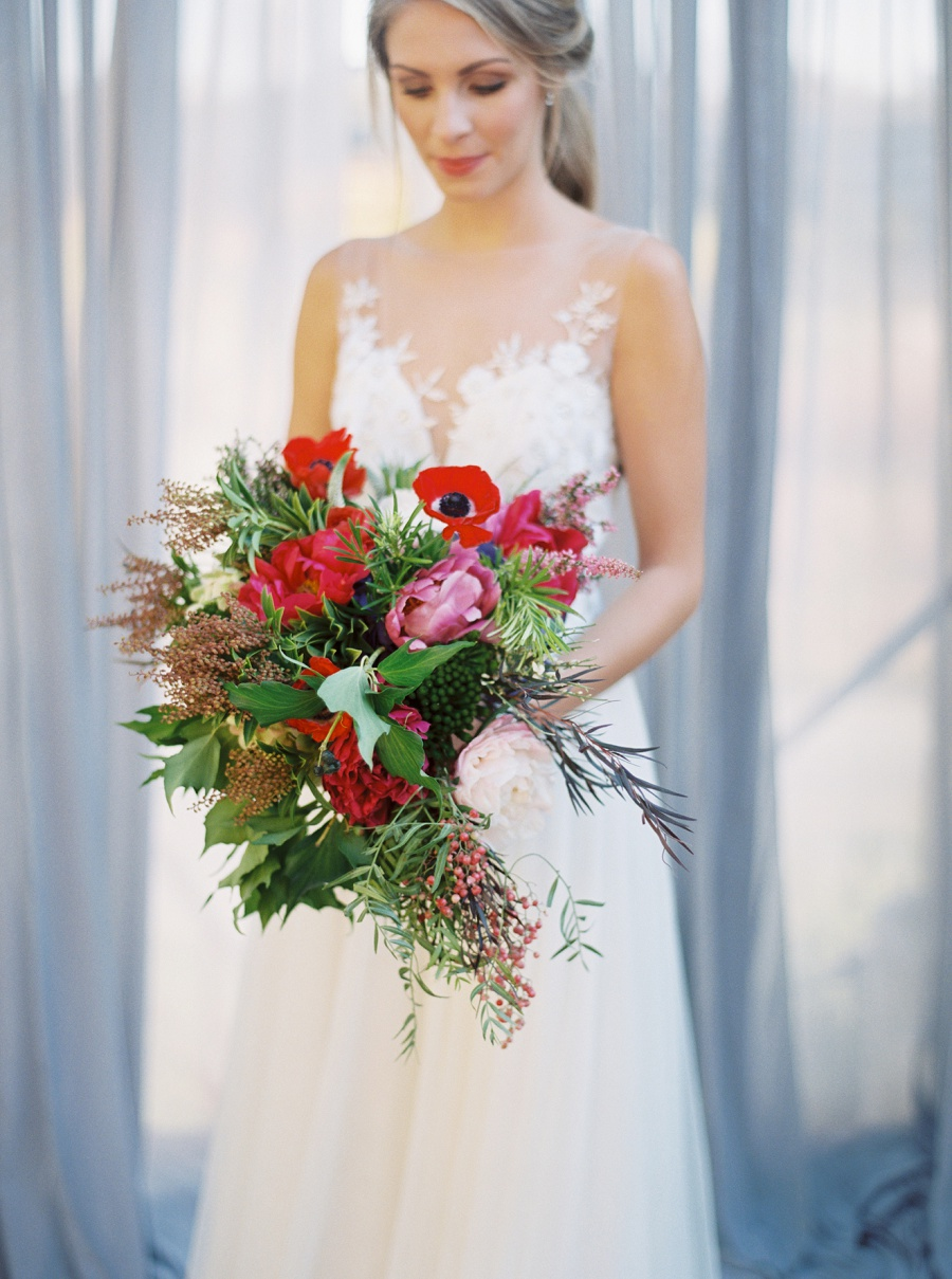 Colorful & Lush - If you're really looking to make a statement with your bouquet, consider incorporating a variety of blooms in different shades to coordinate with your color palette. Abstract bouquets are very popular right now, and lend themselves to creating a unique and one-of-a-kind arrangement for your special day.
