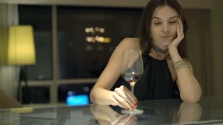 videoblocks-drunk-elegant-woman-drinking-wine-sitting-by-counter-at-home-at-night_bwglyhjob_thumbnail-small01.jpg