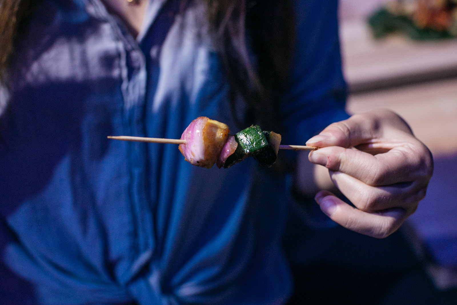 A guest with a skewer. Photo by  Ollie Alexander.