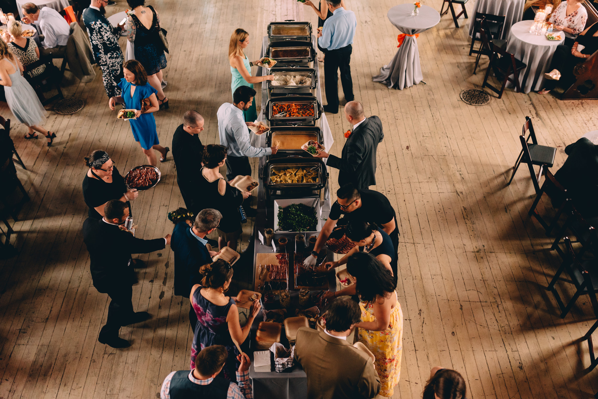 Event guests gather over New Orleans custom taco bar by My House Social for catering at Felicity Church.