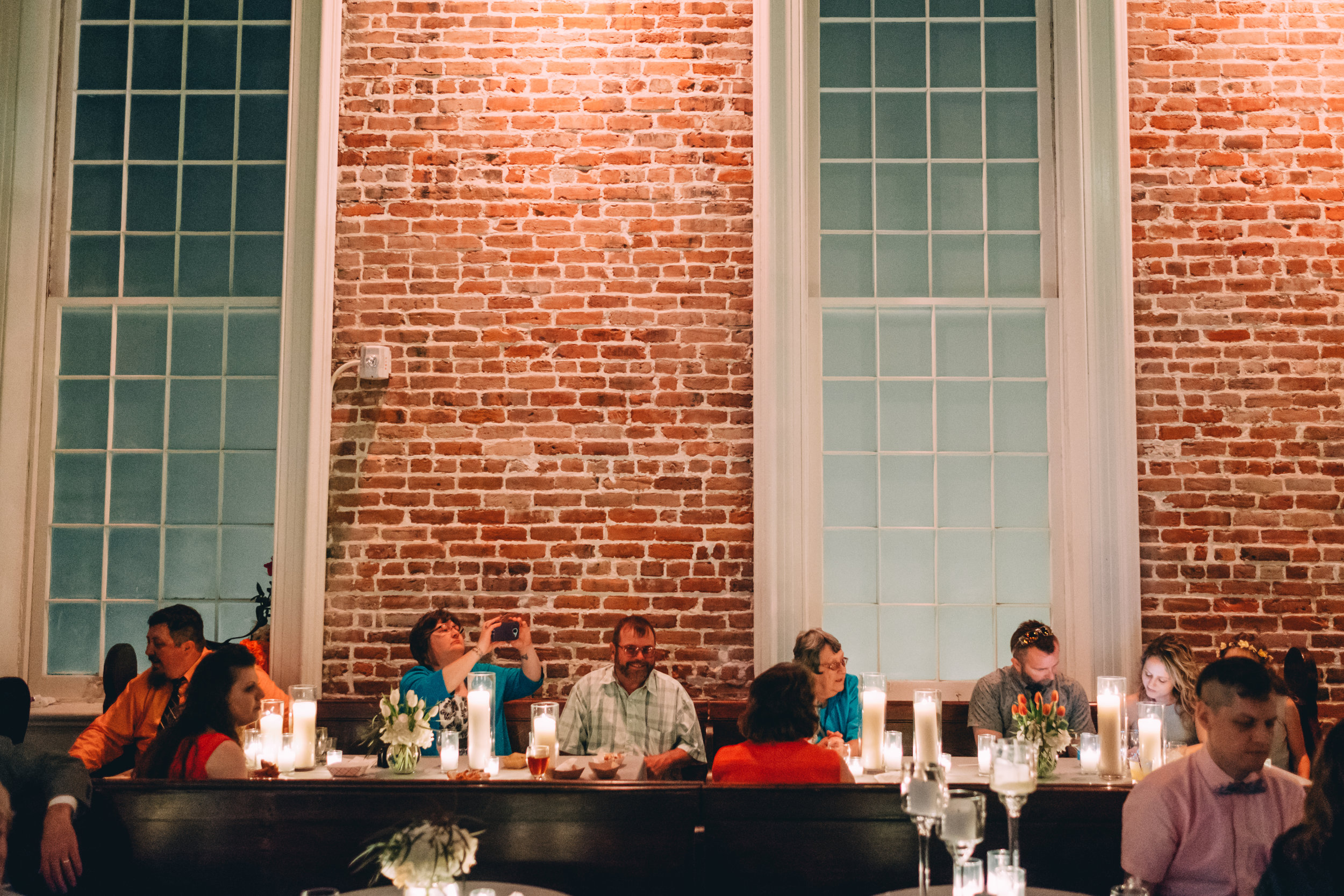 Guests eating together at a family-style setup for New Orleans Catering by My House Social at Felicity Church