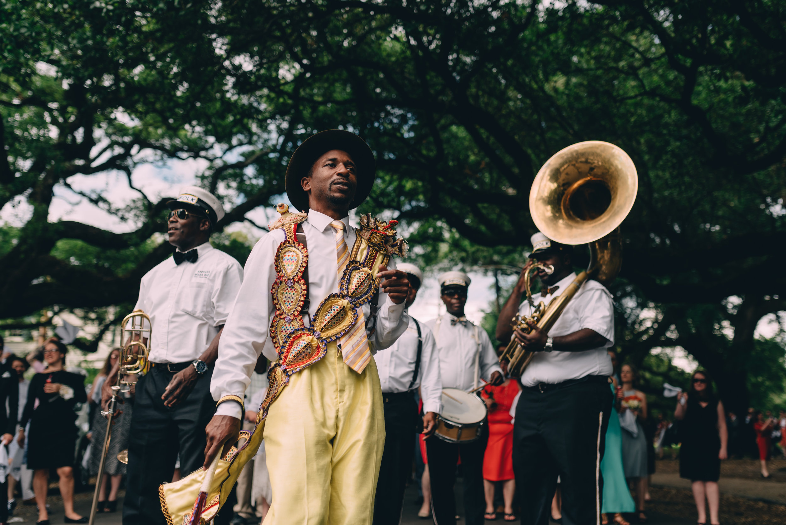 Second line frontman leading the way for guests at New Orleans Wedding near Felicity Church