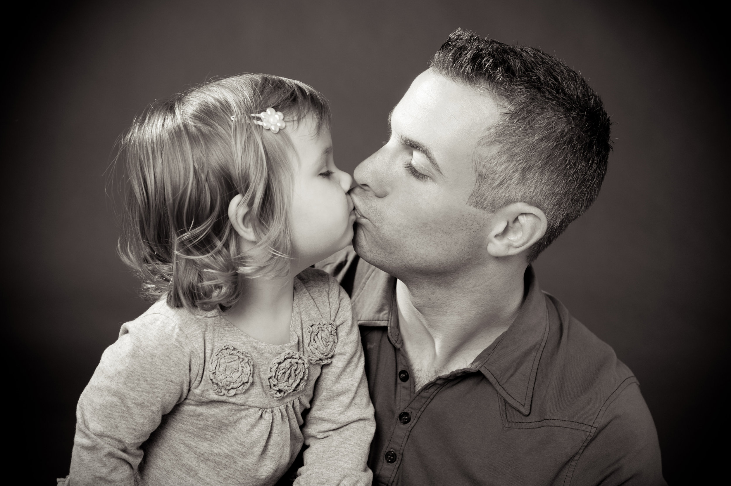 marta hewson - father kissing daughter.jpg