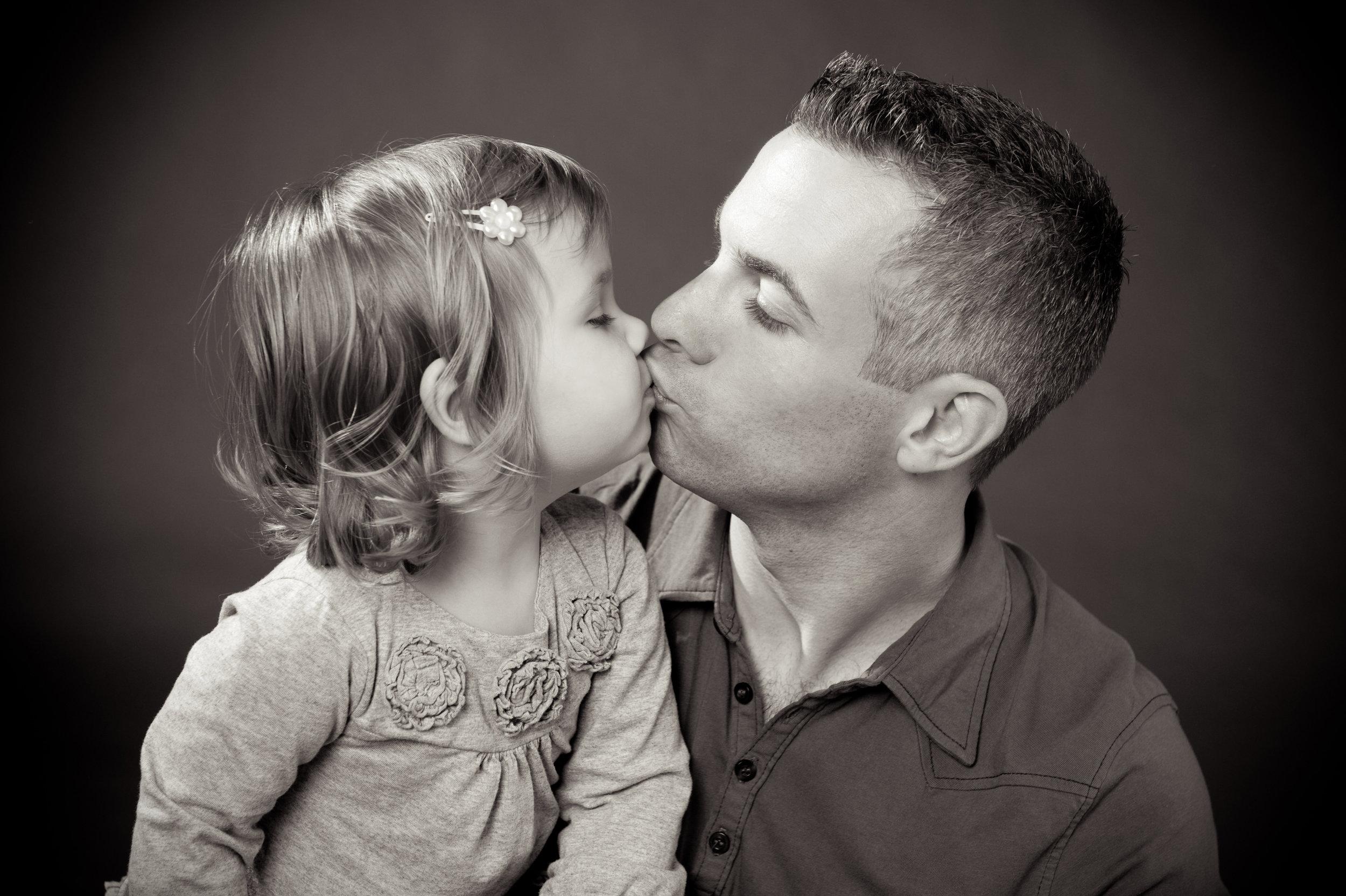 marta hewson - father kissing daughter.jpg